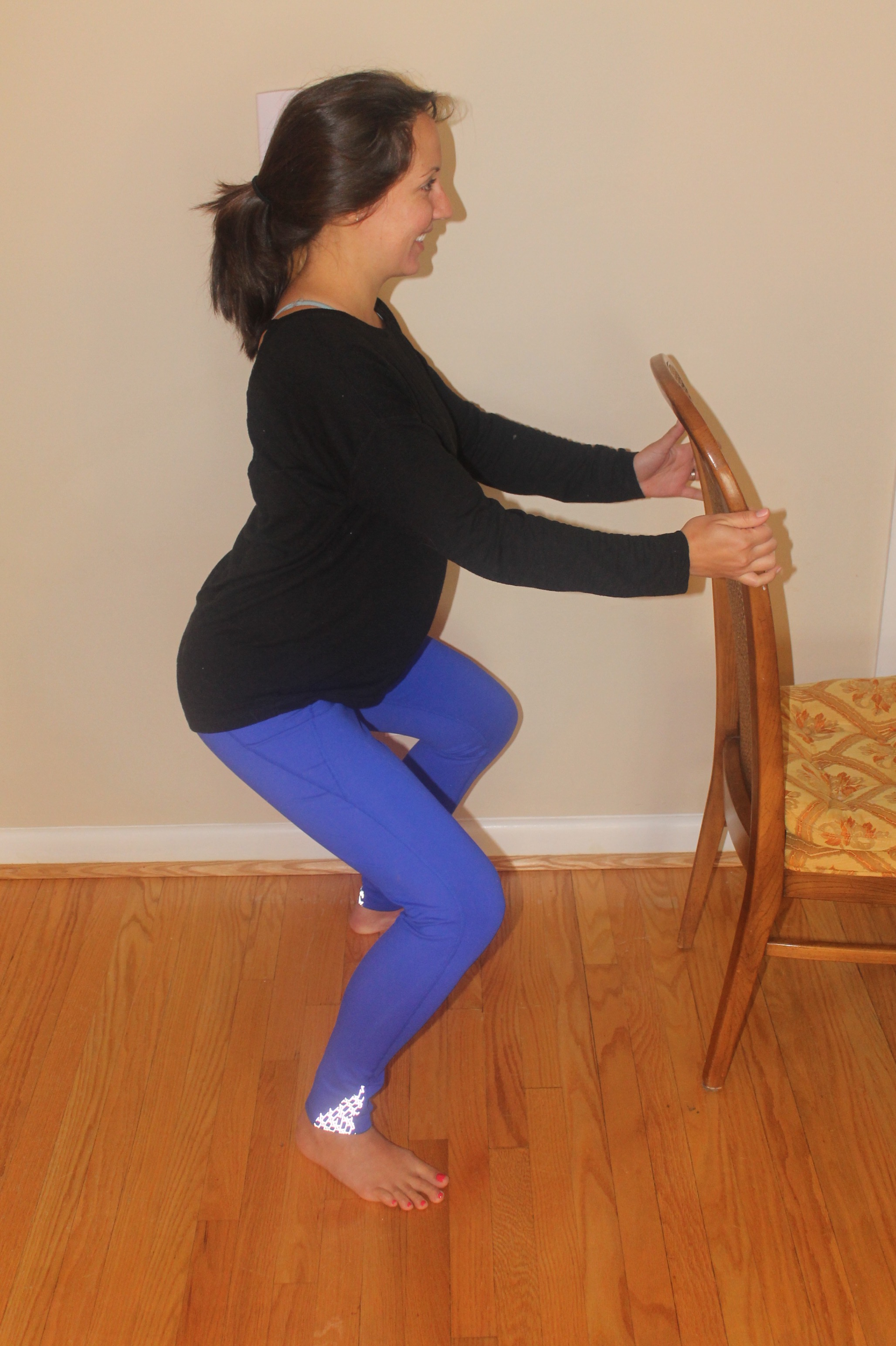 figure 3: Dr. Heppe, 30 weeks pregnant, using a chair for a sumo squat.