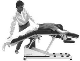 Here is an example of a patient on a flexion distraction table, as the table is slowly being moved into the flexion phase.
