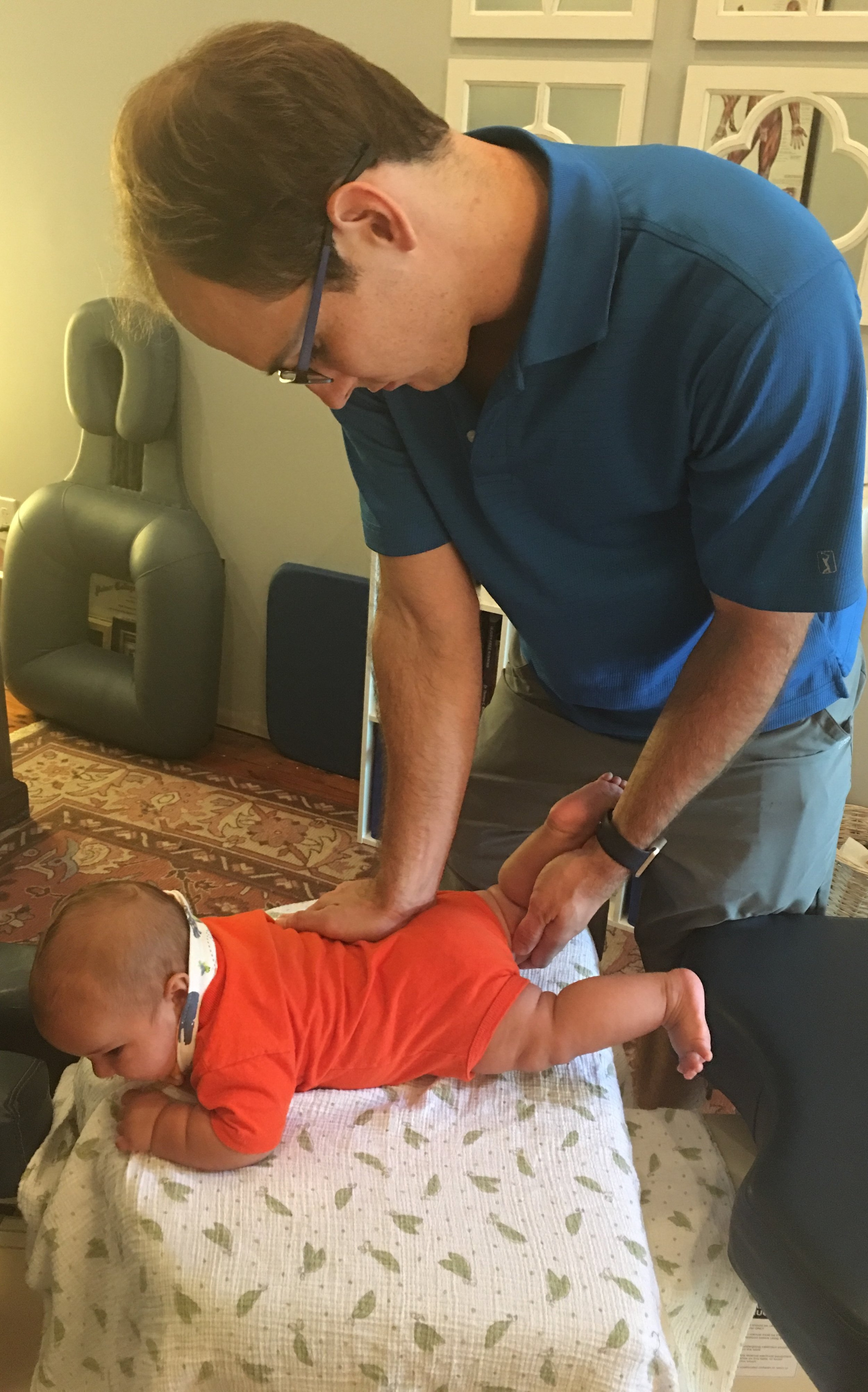 Dr. Scott evaluating the hips and pelvic of a 14 week baby.