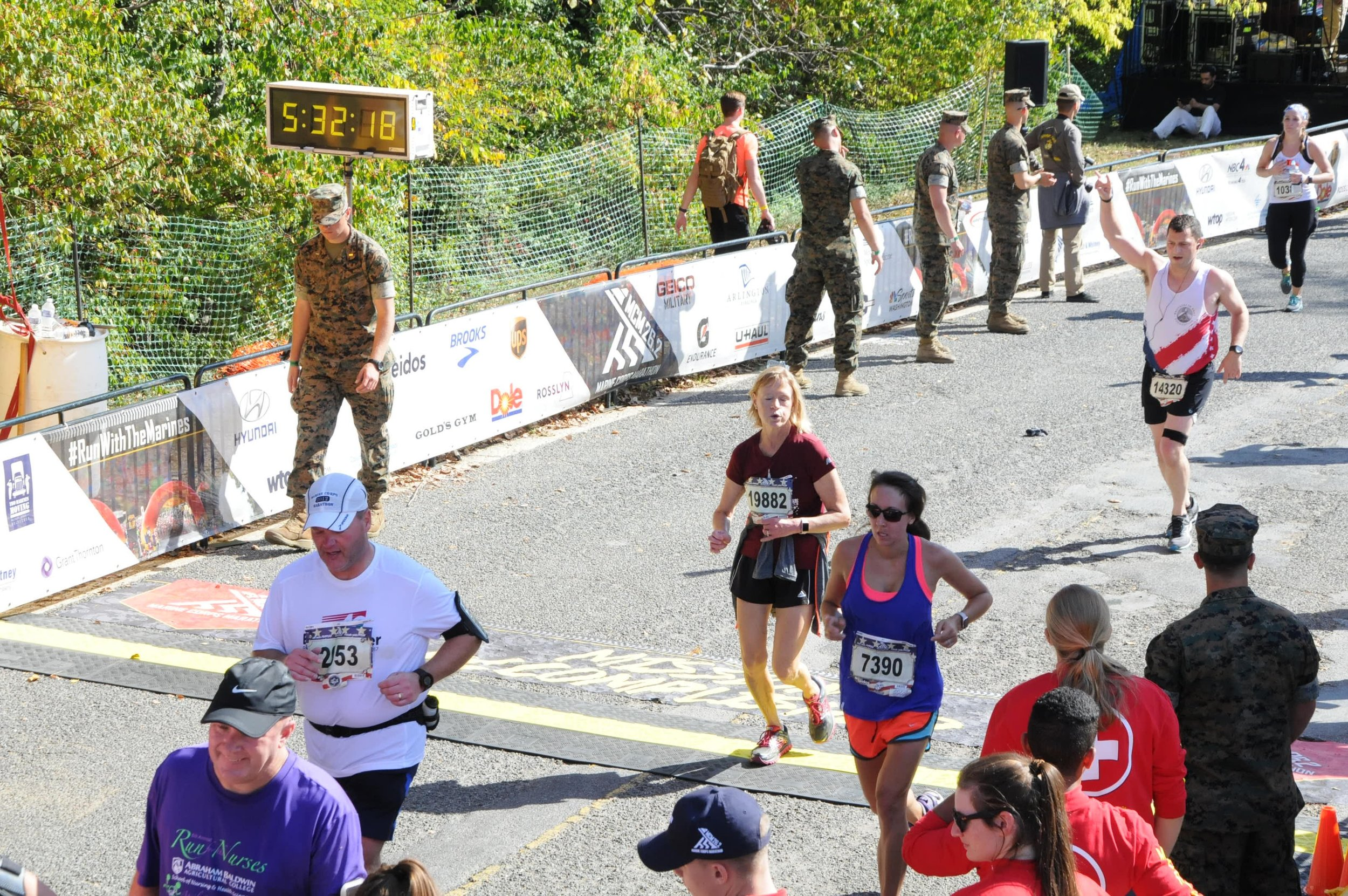 everyone is exhausted at The end of a marathon, as seen above at the Marine corps marathon 2017.  MOre physical activity = Better sleep