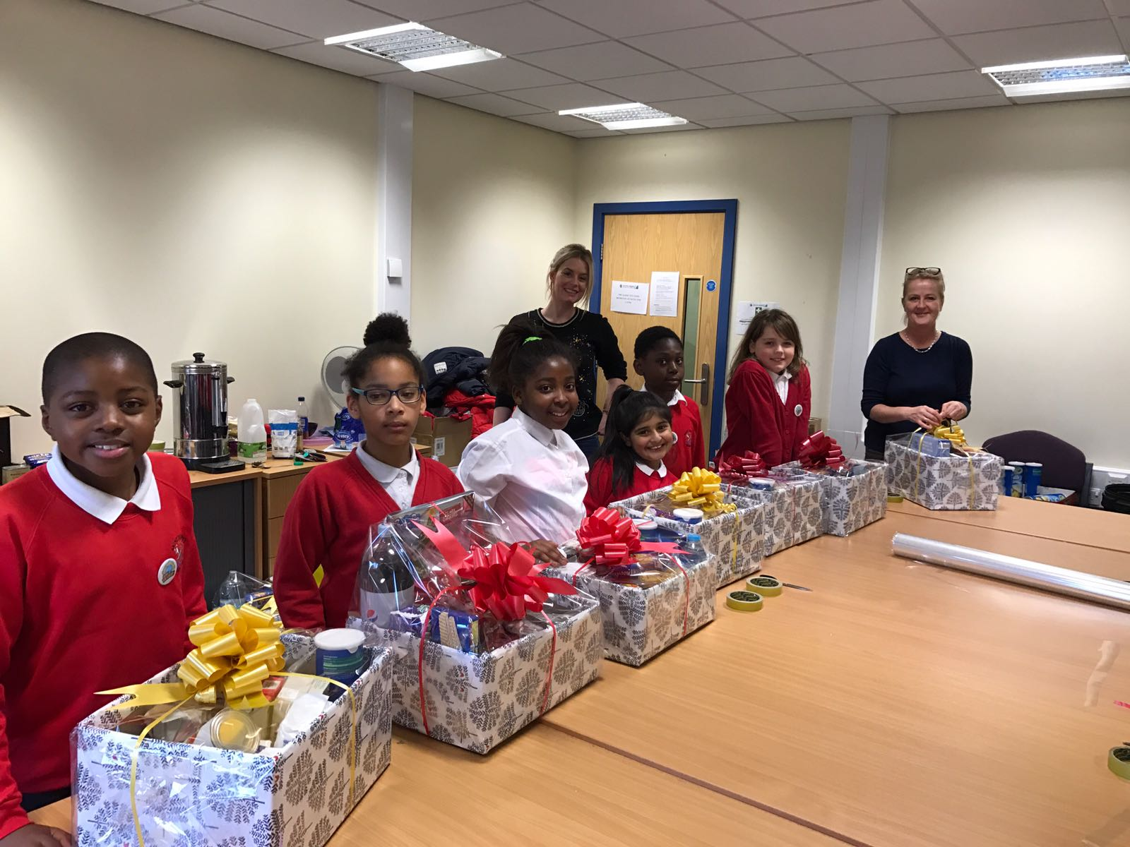 Children from St Joseph's Catholic Primary School Bradford came to help us wrap and pack the hampers