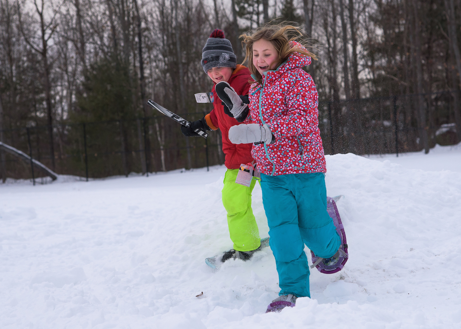 Madeline Wolfgram, 10, and Benjamin Wolfgram, 7, of Scarborough compete in the Snow Shoe Obstacle Course.