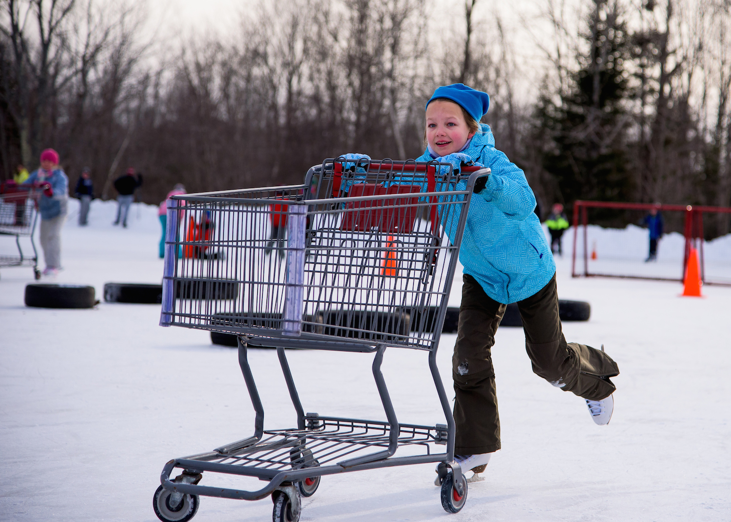 Madelyn Lindsay, 10, of Scarborough pushes a shopping cart through the Obstacle Course.