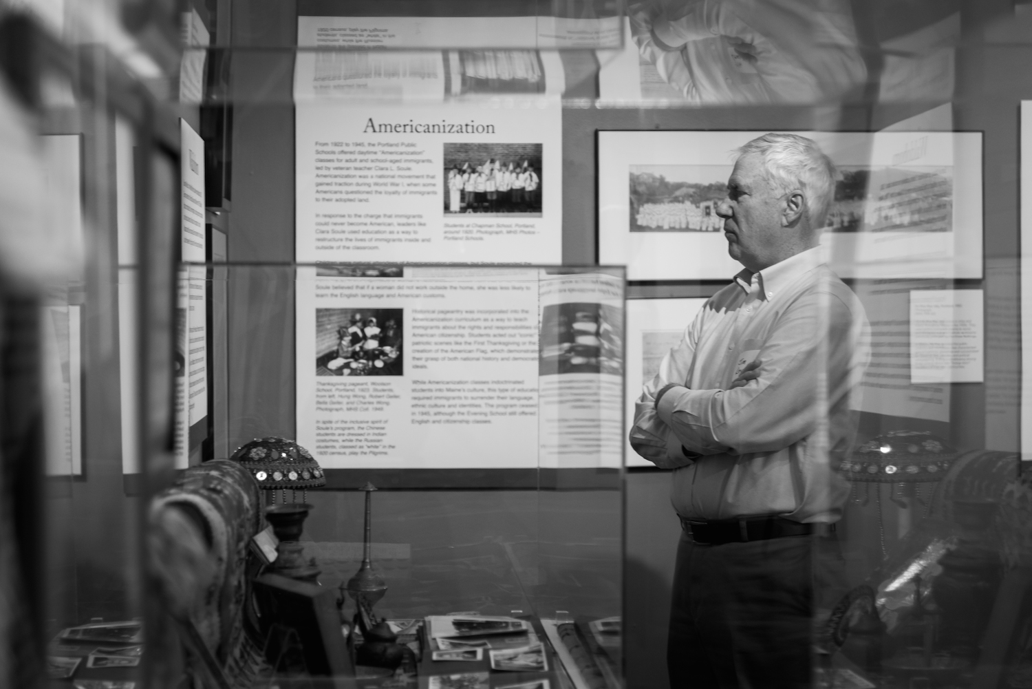 A member of Maine Historical Society takes in artifacts on display for  400 Years of New Mainers , an exhibition on immigration in Maine at Maine Historical Society in Portland on February 4, 2016.