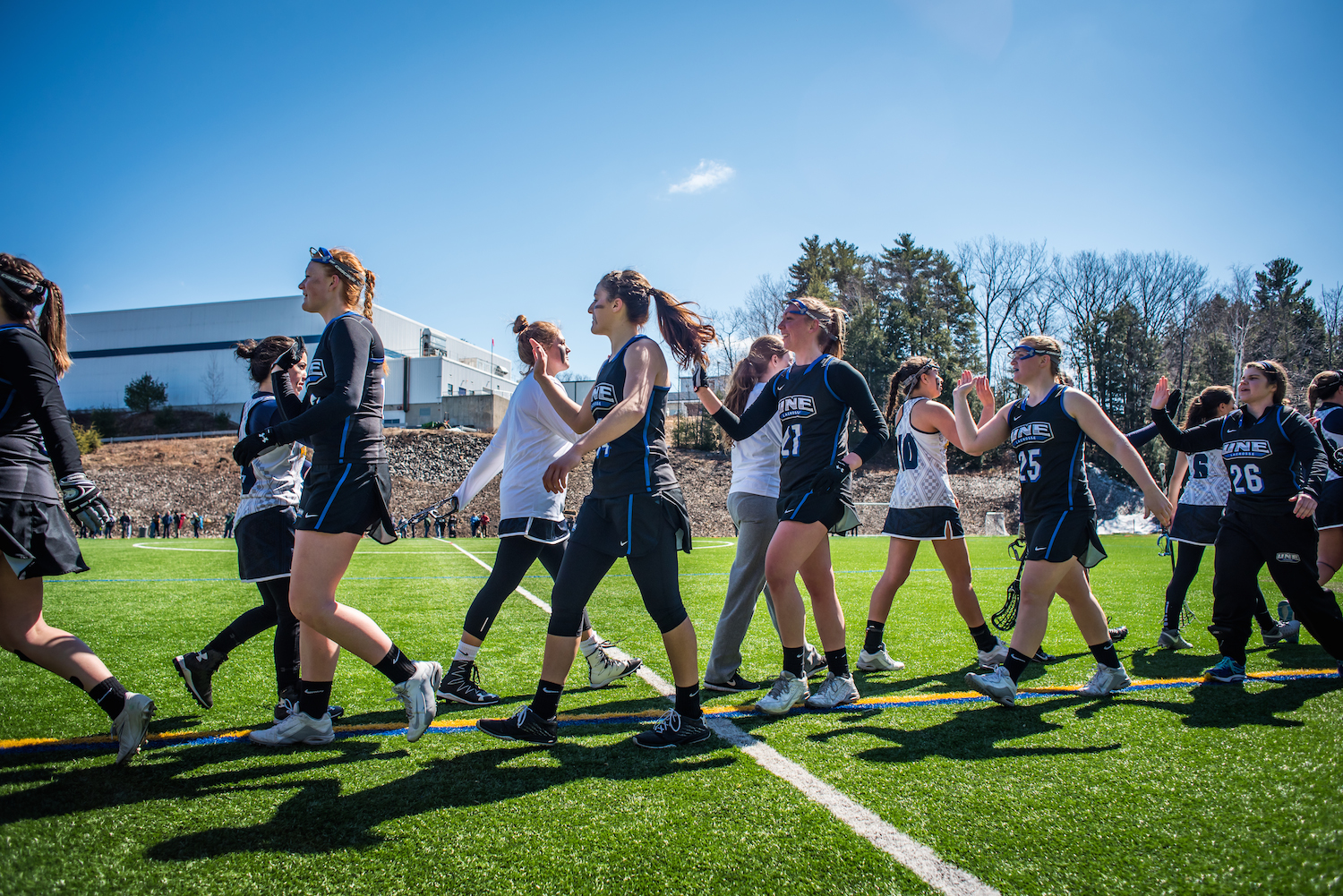 The USM and UNE women's lacrosse teams congratulate each other following a game at the USM lacrosse field in Gorham, Saturday, March 26, 2016.