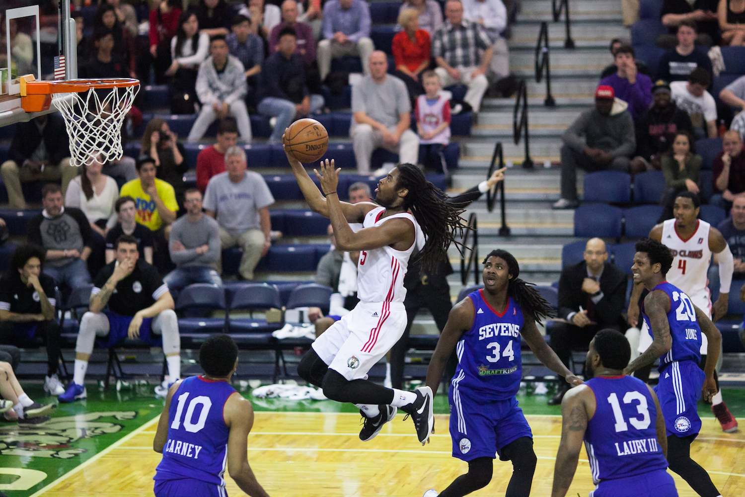 Marcus Thornton of the Maine Red Claws leaps up to a basket at the Portland Expo,Thursday, March 31, 2016.