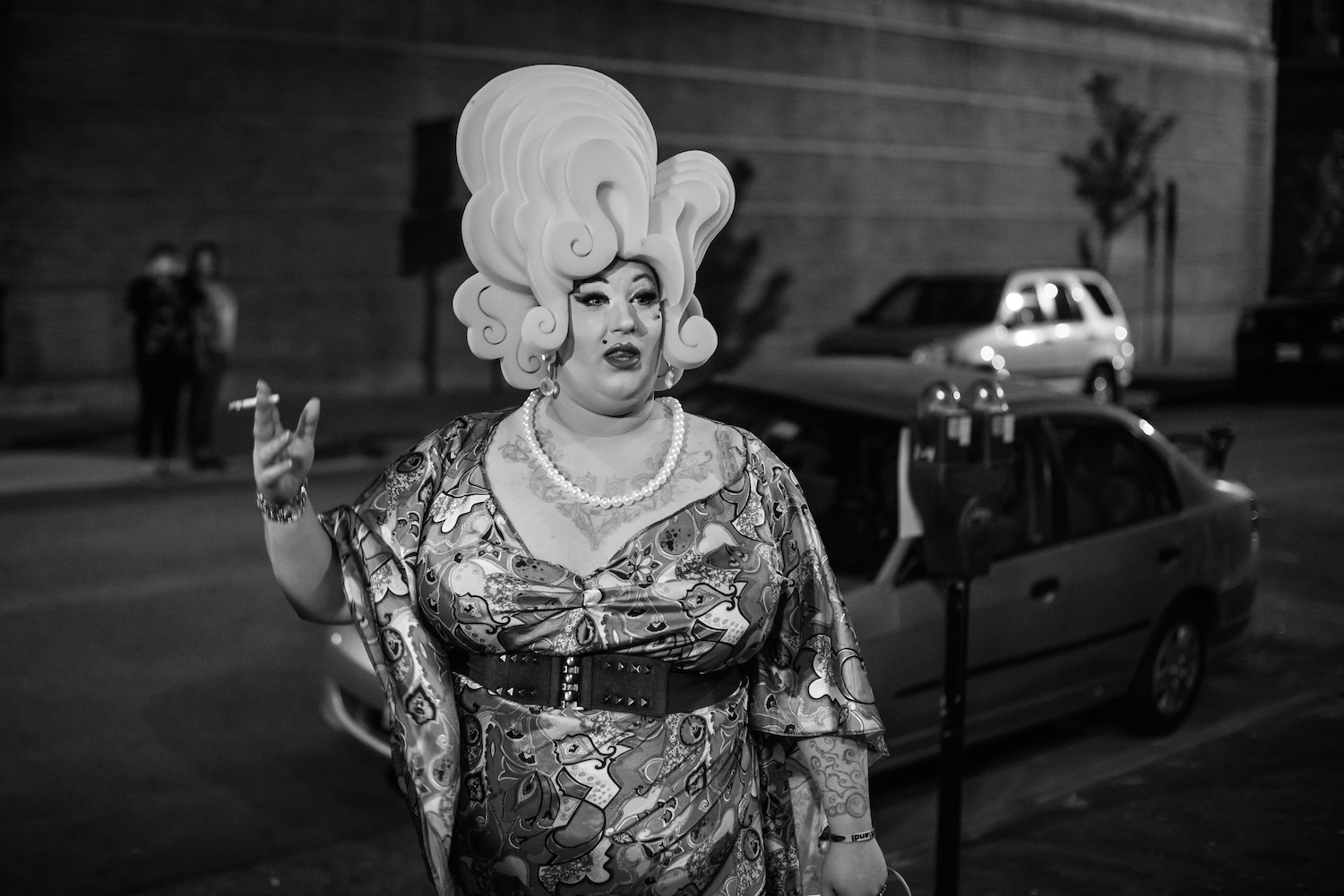 Miss Eon, drag queen, takes a drag outside the Pride Portland kick-off party at Grace Restaurant in Portland on June 10, 2016.