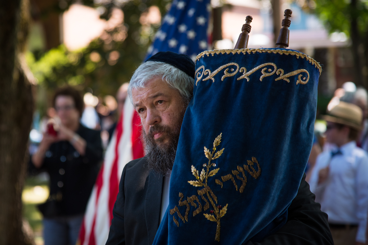 Rabbi Moshe Wilansky of Chabad of Maine carries a torah from Portland's Shaarey Tphiloh synagogue on Noyes Street to the congregation's new home at Temple Beth El on Deering Avenue, Sunday, August 21, 2016.