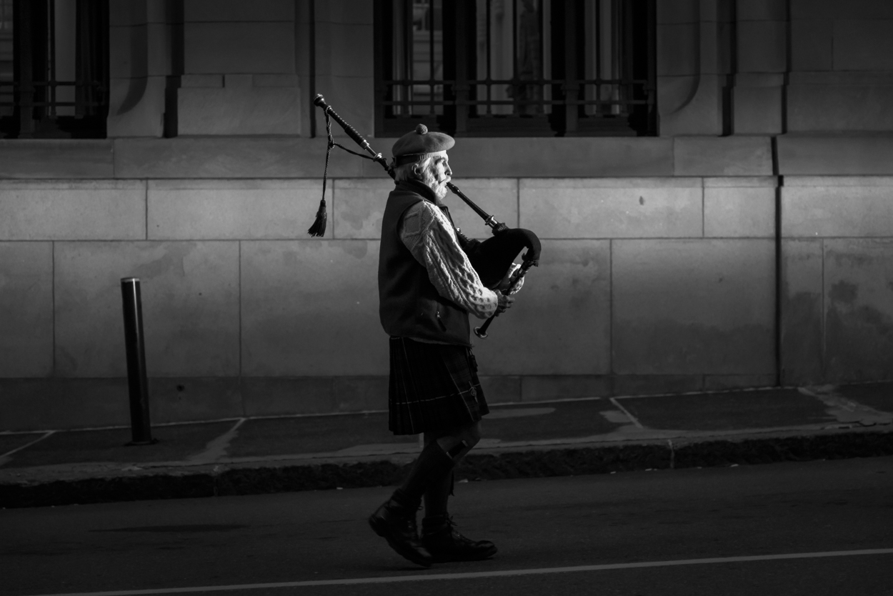 A bagpiper leads a candlelight procession up Preble Street in Portland to honor the passing of Maine's homeless at the annual Portland Homeless Persons' Vigil on December 21, 2015.