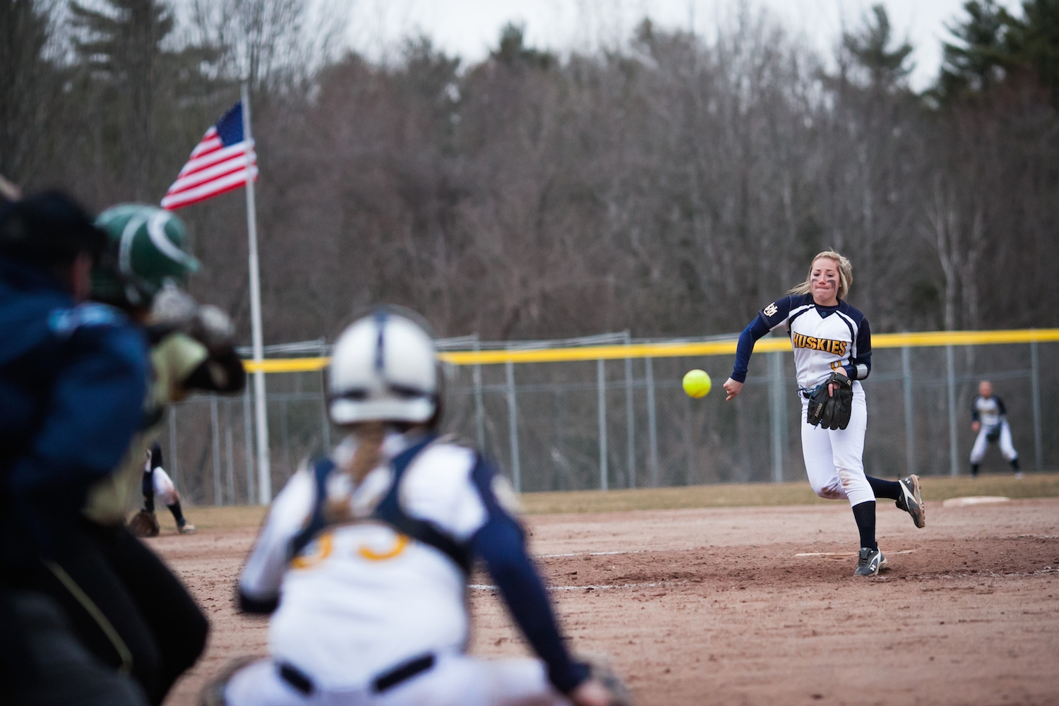 Freshman Amber Kelly of the Huskies hurls a pitch during the fifth inning of the last game of a double header against the Husson U. Eagles at the USM softball field in Gorham, Thursday, April 7, 2016.