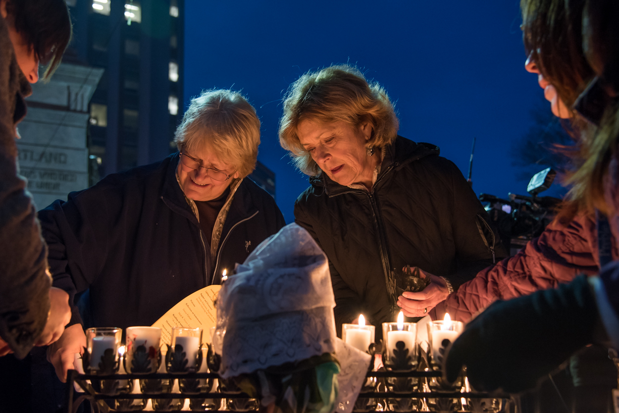 Community members light candles to honor the passing of Maine's homeless at the annual Portland Homeless Persons' Vigil at Monument Square in Portland on December 21, 2015.
