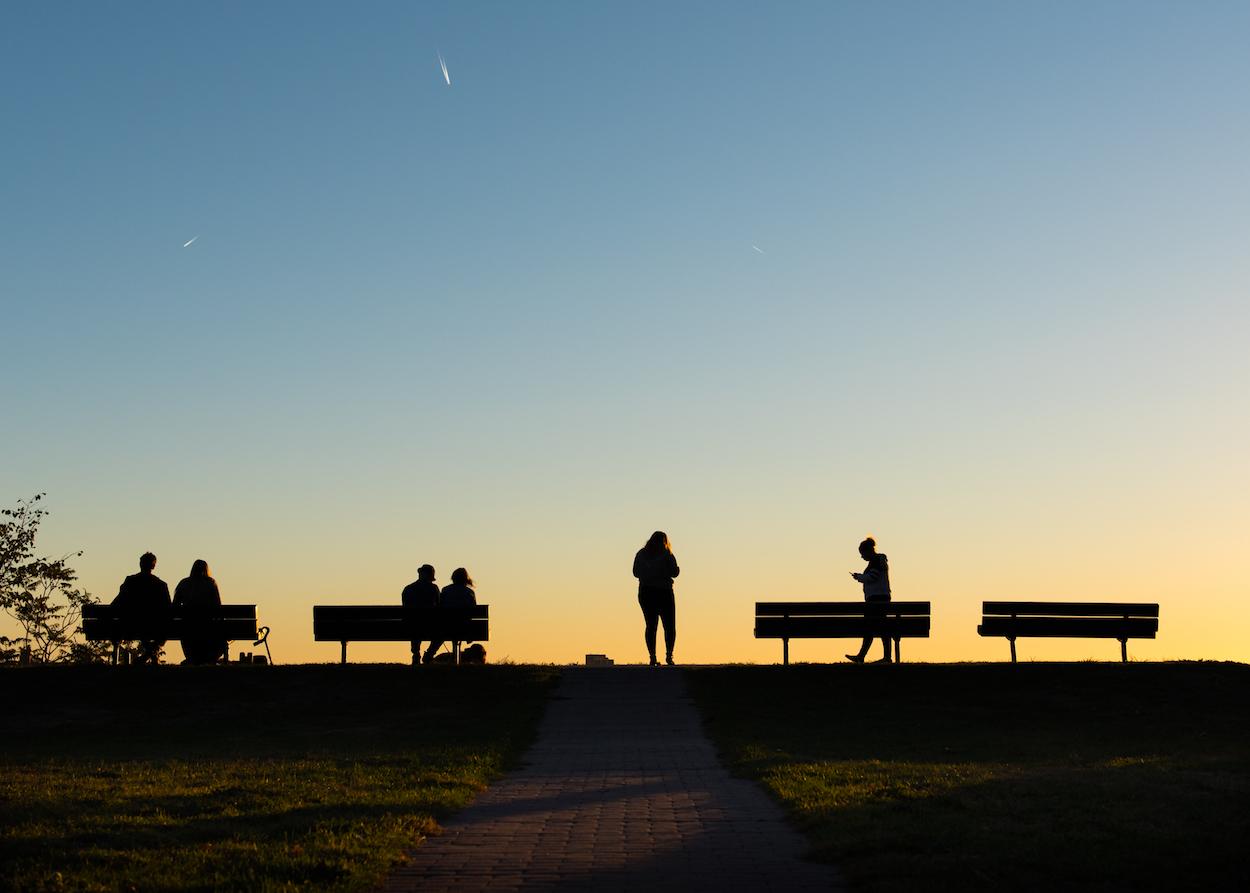 Visitors enjoy the sunset at Fort Sumner Park on Munjoy Hill in Portland on October 6, 2016.