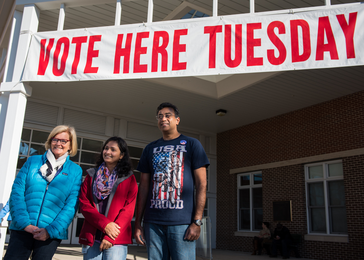 Congresswoman Chellie Pingree poses with Anamika Pradeep and her husband Pradeep Sathyanarayana outside Scarborough High School. After 17 years of residency, the couple became U.S. citizens in 2015 and voted for the first time this Election Day.