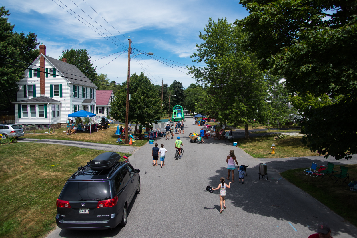 Residents in the Rosemont neighborhood of Portland make their way to a block party on Edwards Street Saturday, July 30, 2016.