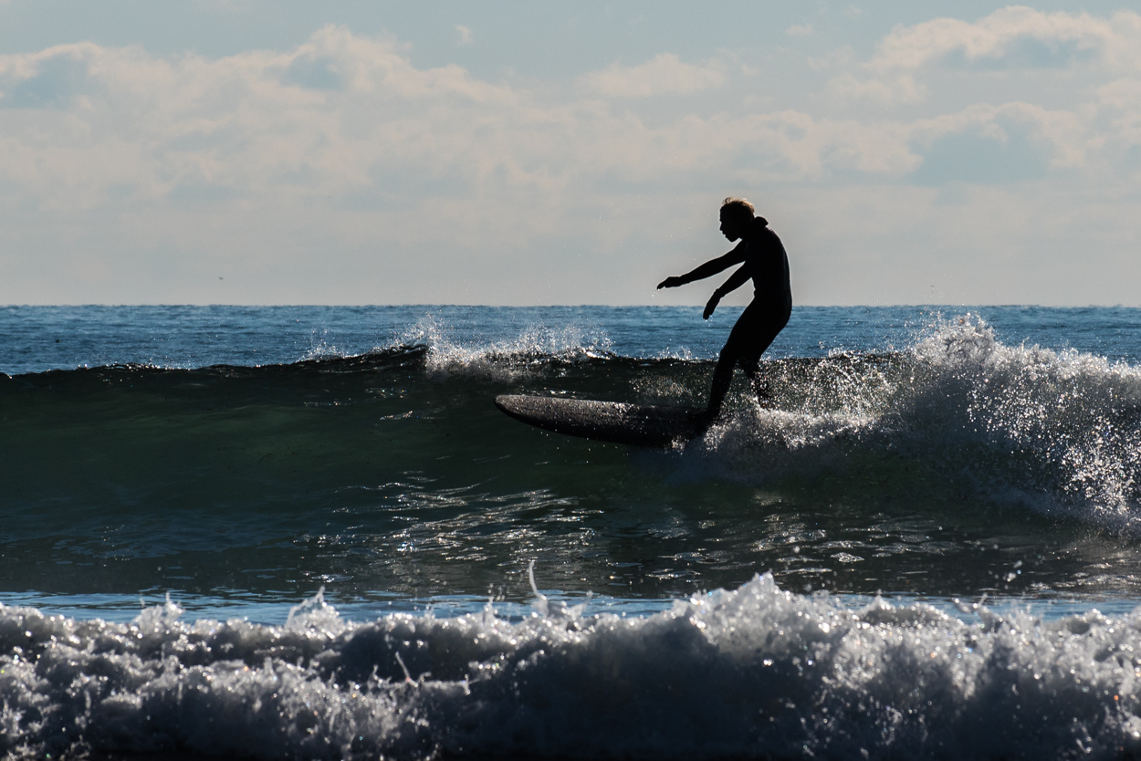 A surfer takes advantage of the relatively balmy temperatures and good waves Tuesday, December 13, at Higgins Beach in Scarborough.