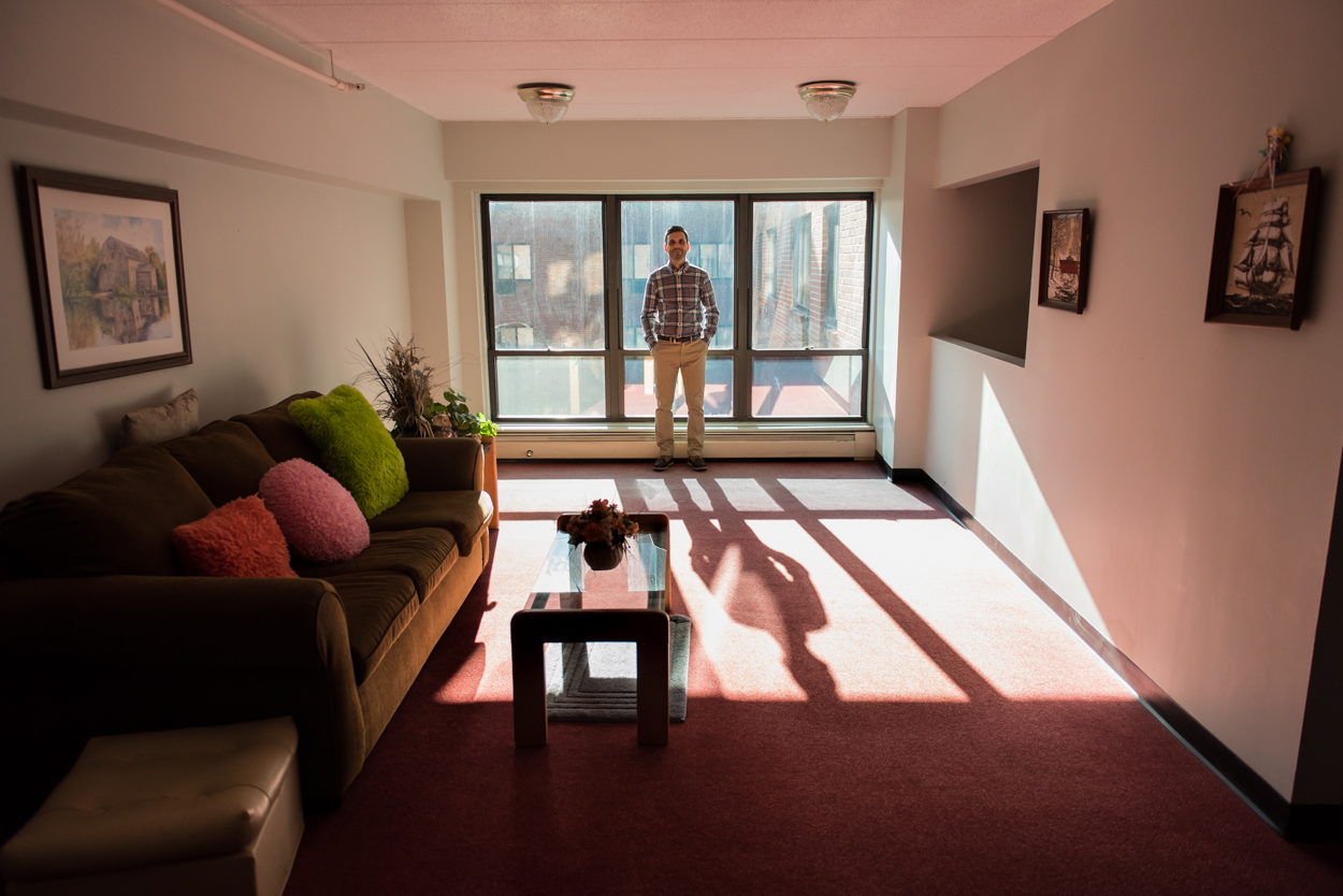 David Young, Maine Hardware E-commerce Manager, in the middle of a lighting evaluation at an apartment complex on High Street in Portland Tuesday, January 31, 2017.