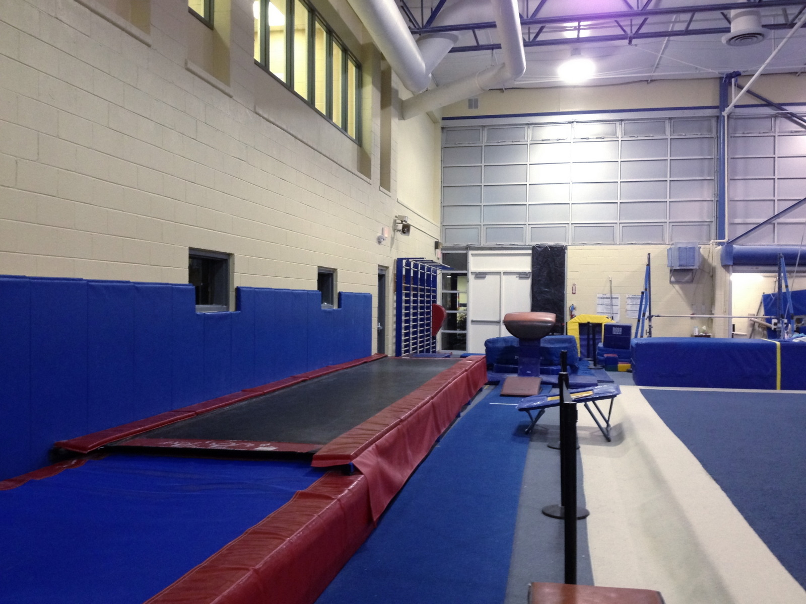 """300 spectator seating capacity in gym  Additional viewing in upstairs observation area  Tiffin Tumble Track Trainer  Tiffin 4 1⁄2 """" Foam Block Floor"""