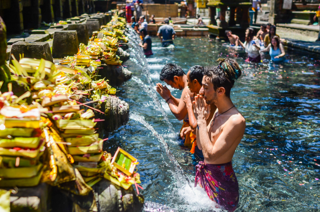 """Hindu Balinese Water Temple Purification Ceremony - """"Water does not resist. Water flows. When you plunge your hand into it, all you feel is a caress. Water is not a solid wall, it will not stop you. But water always goes where it wants to go, and nothing in the end can stand against it. Water is patient. Dripping water wears away a stone. Remember that, my child. Remember you are half water. If you can't go through an obstacle, go around it. Water does."""" ― Margaret Atwood, The Penelopiad"""