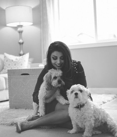 Simone Brown, personal and organizational coach from Calgary, sitting with her dogs