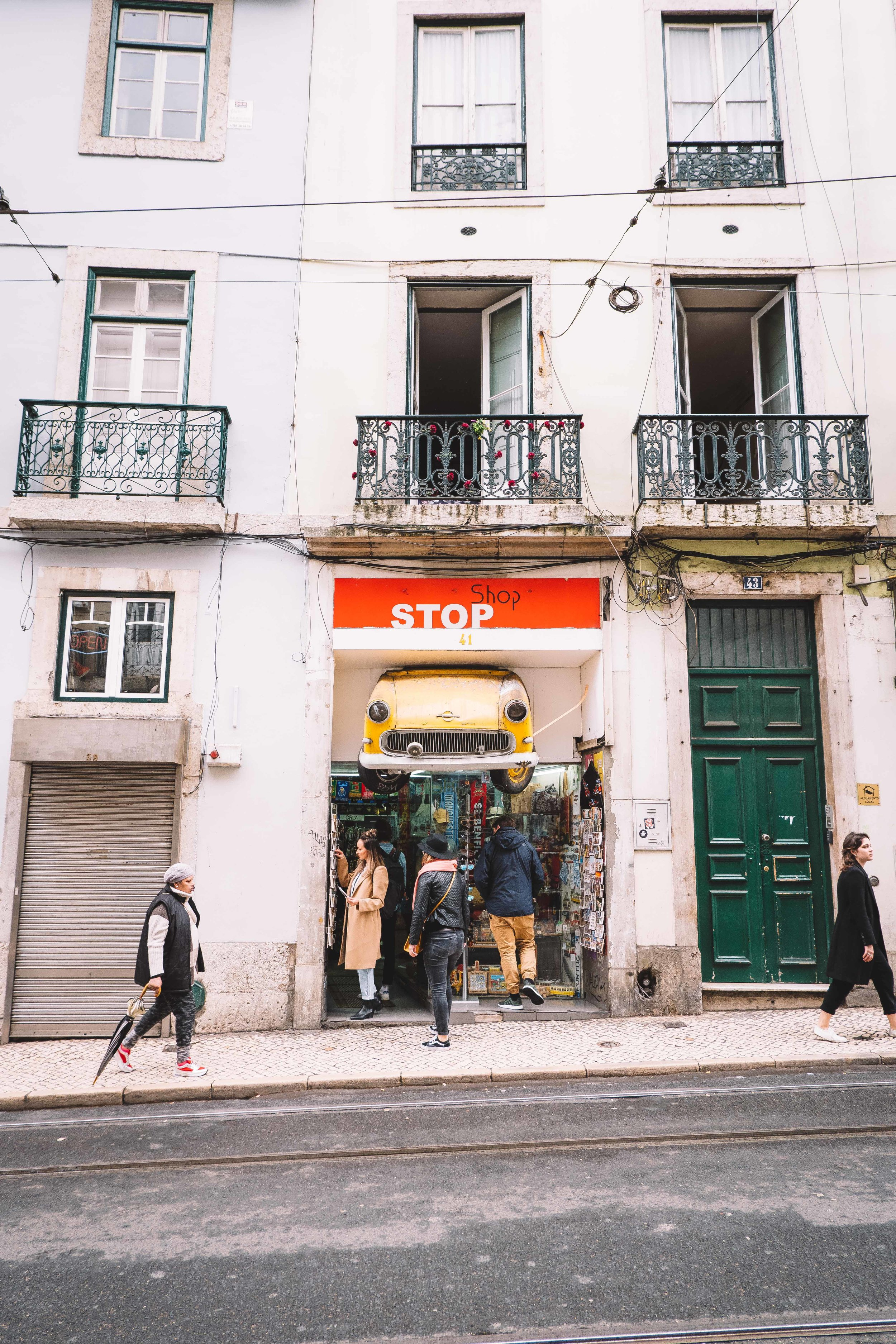 Picking out postcards at the Stop Shop in Lisbon