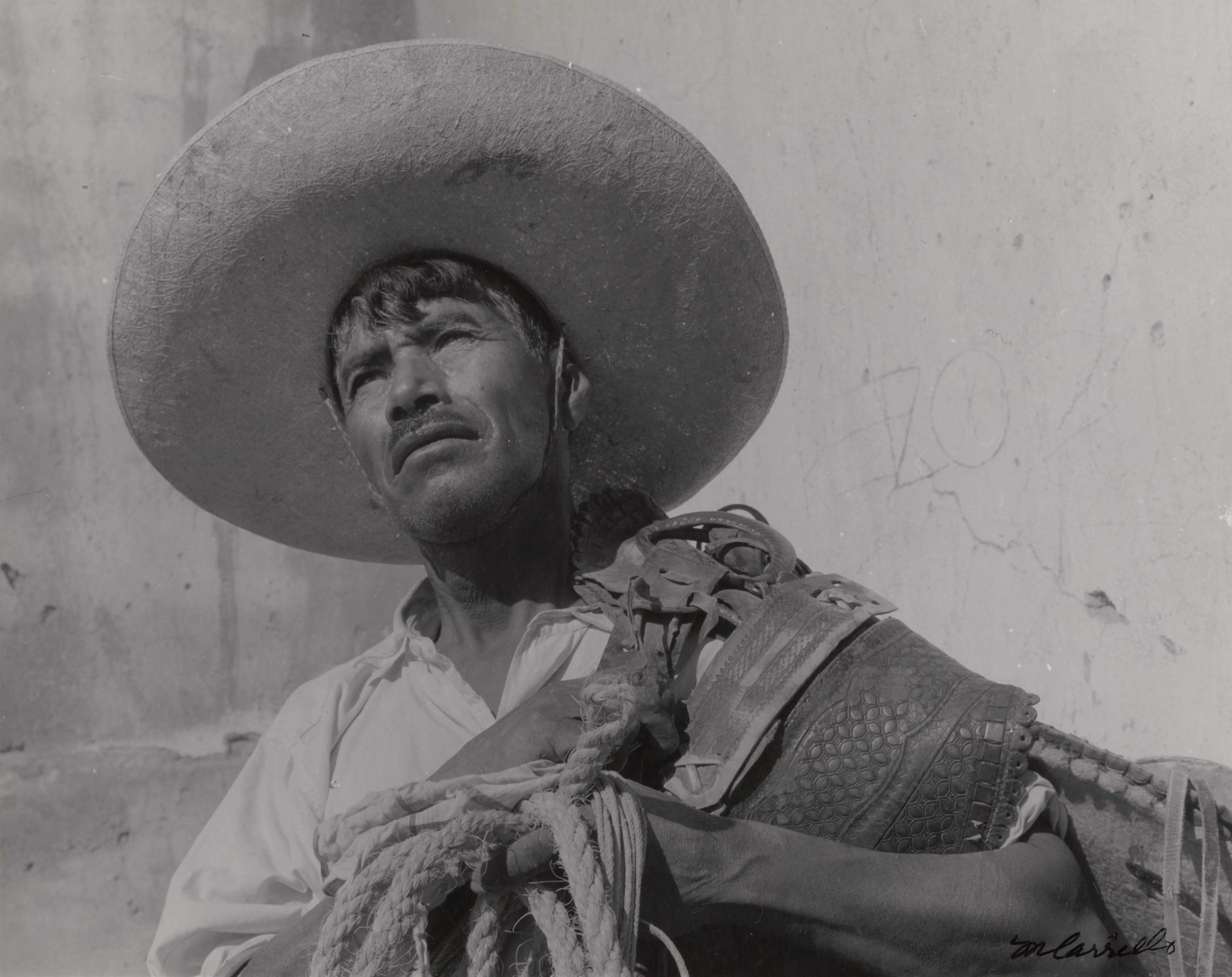 Cowboy with Saddle and Sombrero  (Santa Rosa, Guanajuato), 1960. Black & White photograph on paper. 8 x 10