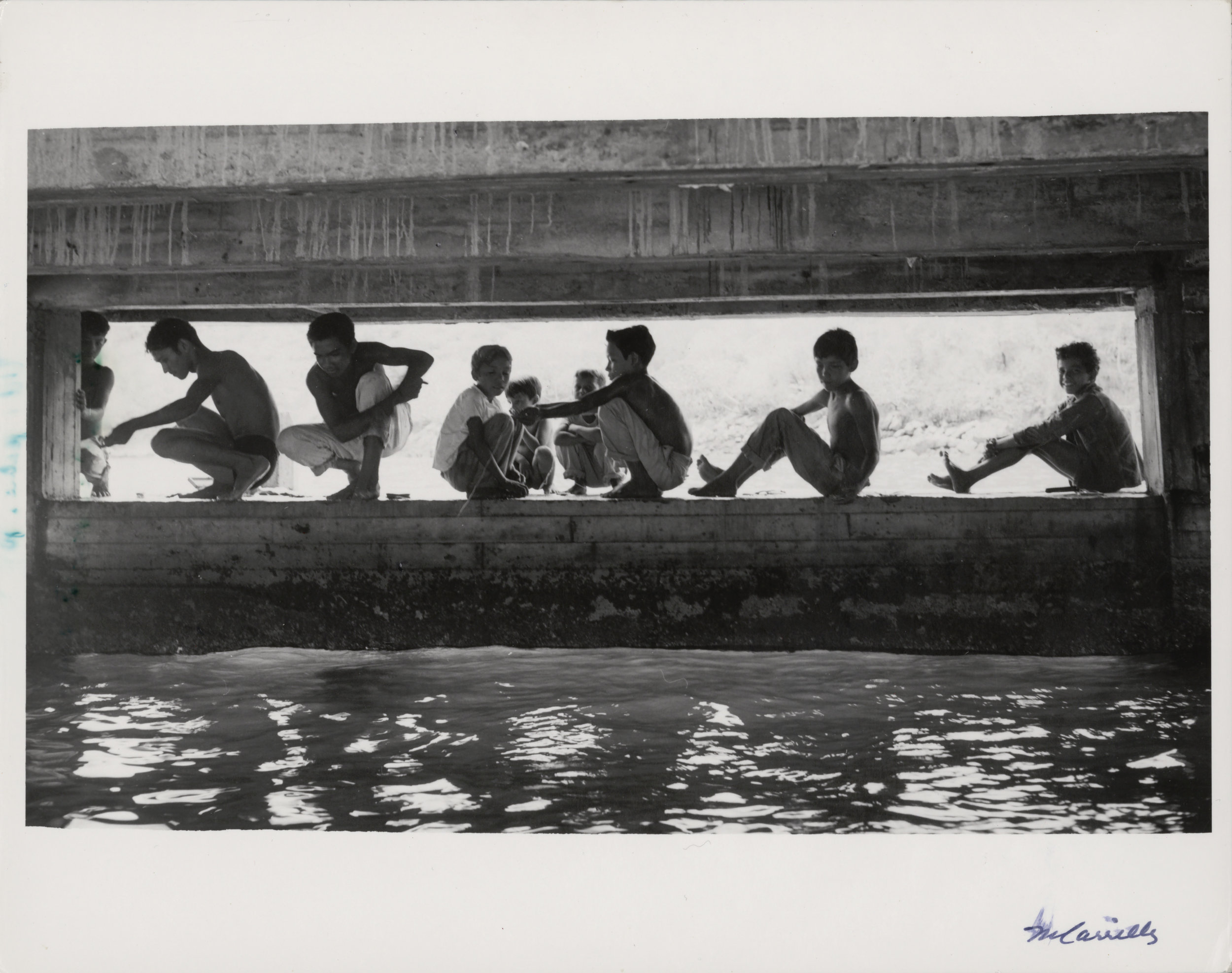 Boys on Wall at Water's Edge , c. 1955-75. Black & White photograph on paper. 8 x 10