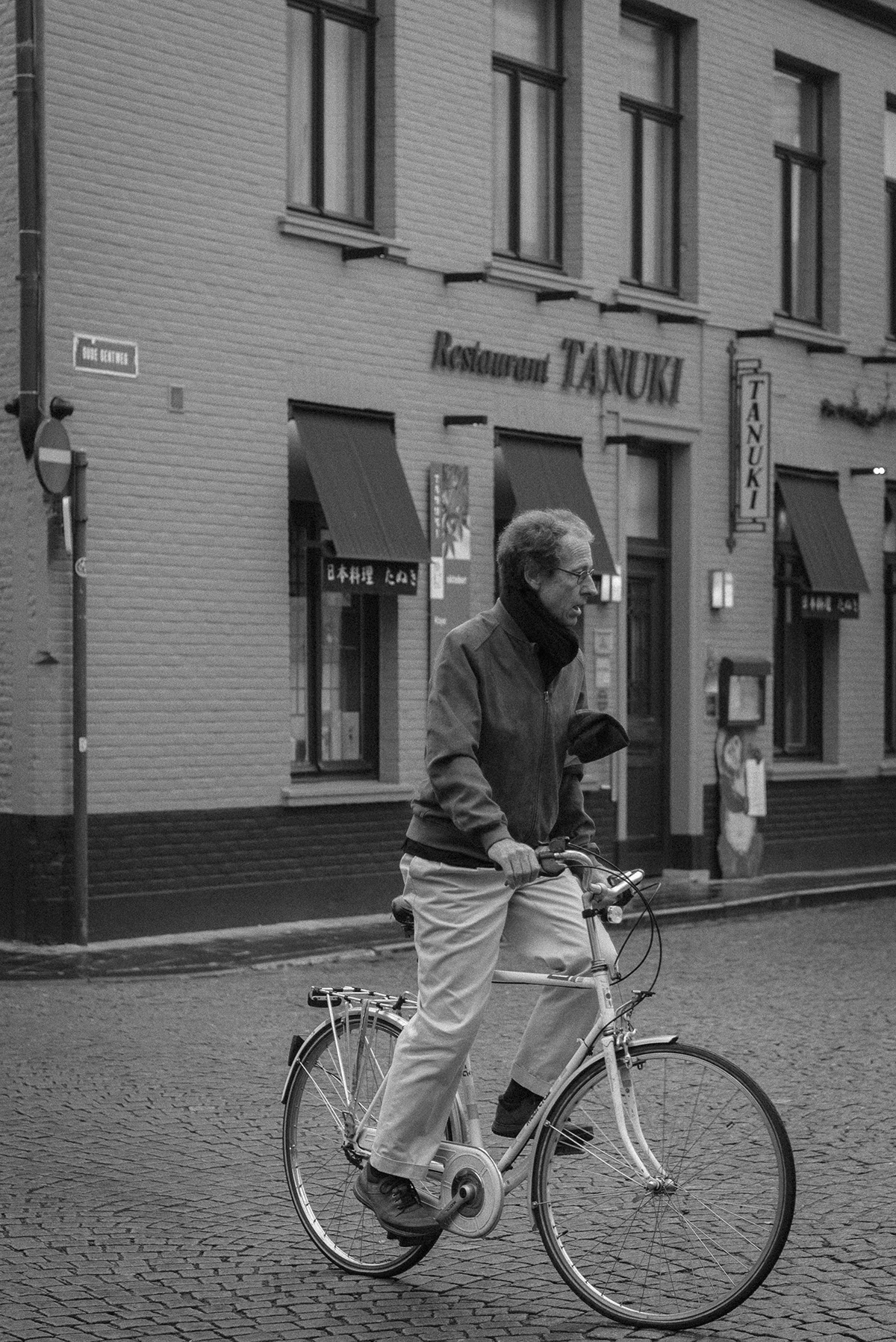 man on bicycle - Bruges - black and white photograph - Patricia Martins Yellowish blog