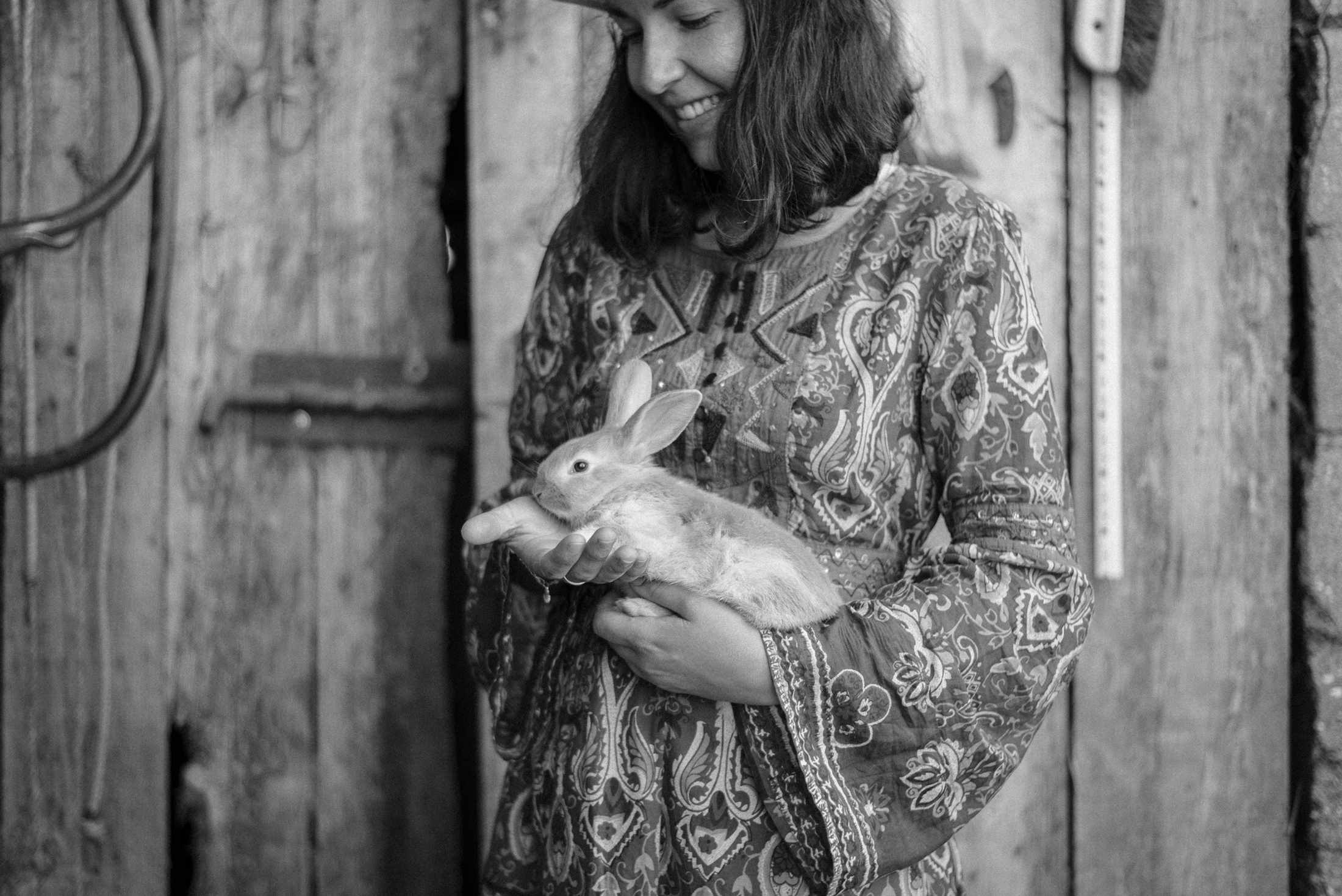 holding a little rabbit Portrait Photography Black and White