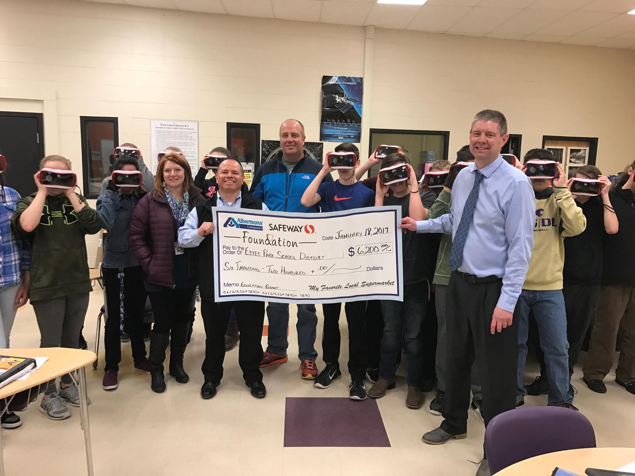 Here, Estes Park Safeway Manager, Eddie Martinez, presents the Estes Park Middle School with a check for $6,200.00.