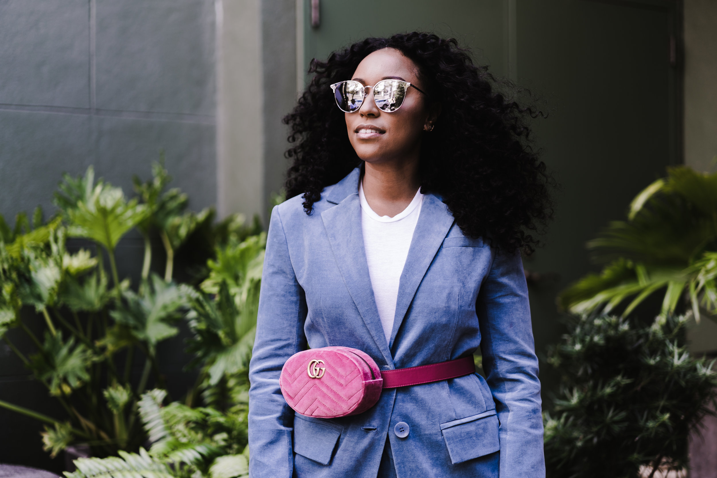 TIBI  Corset-back blazer (Shop it  here ),  GUCCI  belt bag (Shop it  here ),  SAINT LAURENT  mirrored sunglasses (Shop it  here )