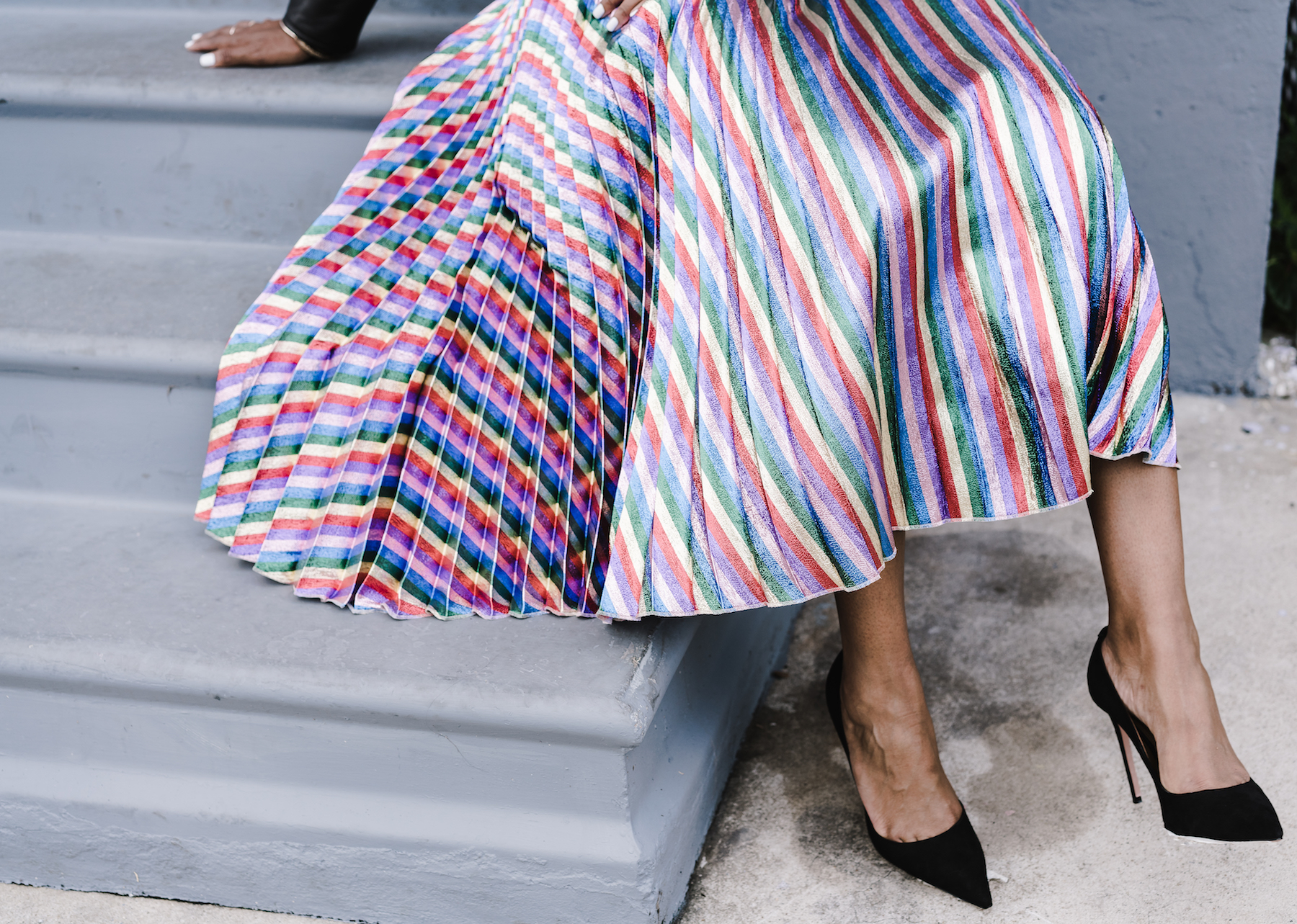 GUCCI Striped high-rise pleated midi skirt (Shop it  here ), AQUAZZURA Simply Irresistible suede pumps (Shop it  here )