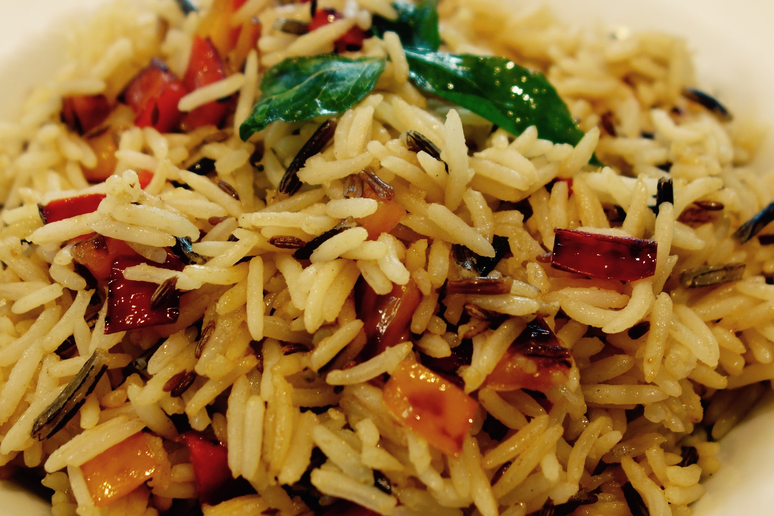 Jazzing up plain boiled rice with cumin and peppers.