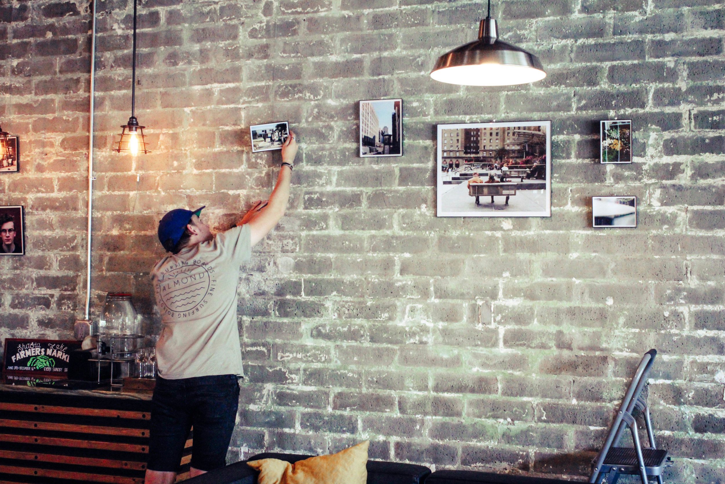 Daniel Bigelow, Local Film Photographer hanging his Art Show for the month of September