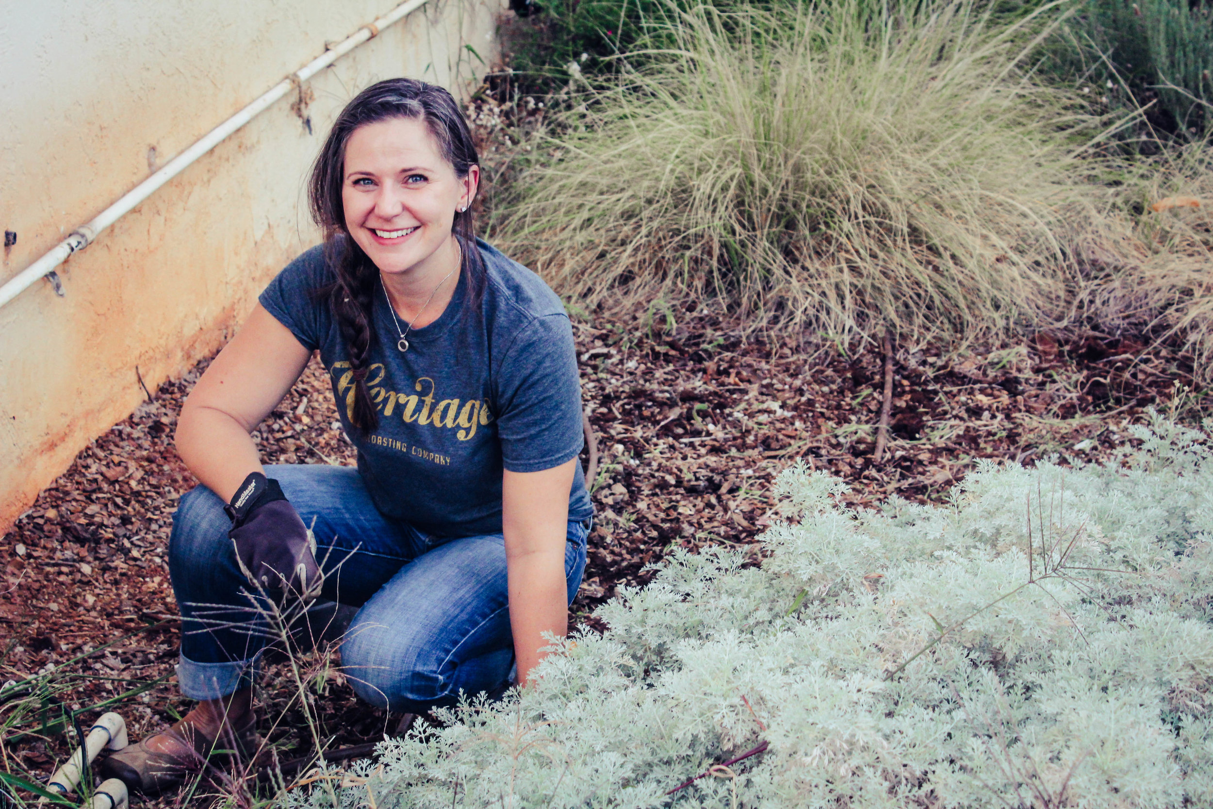 Sara pulling weeds at an Evening Garden Party in the Heritage Community Garden in Shasta Lake, Ca.