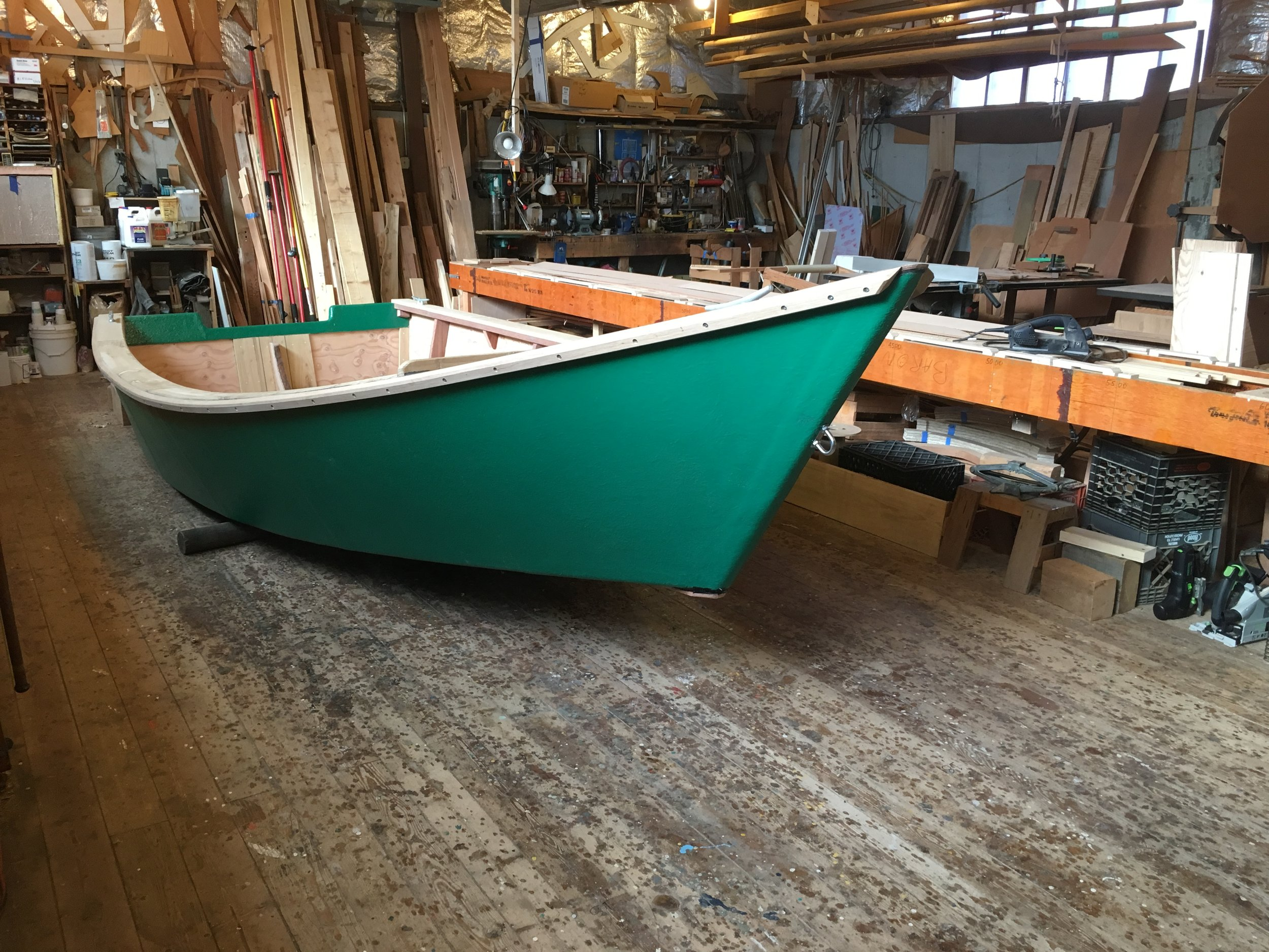18' Work Skiff, on the rollers and ready to go out the door.