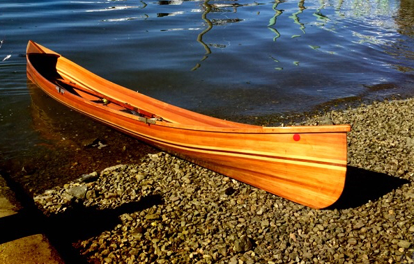 A great boat- full length red cedar strip planked, glassed and varnished inside and out.