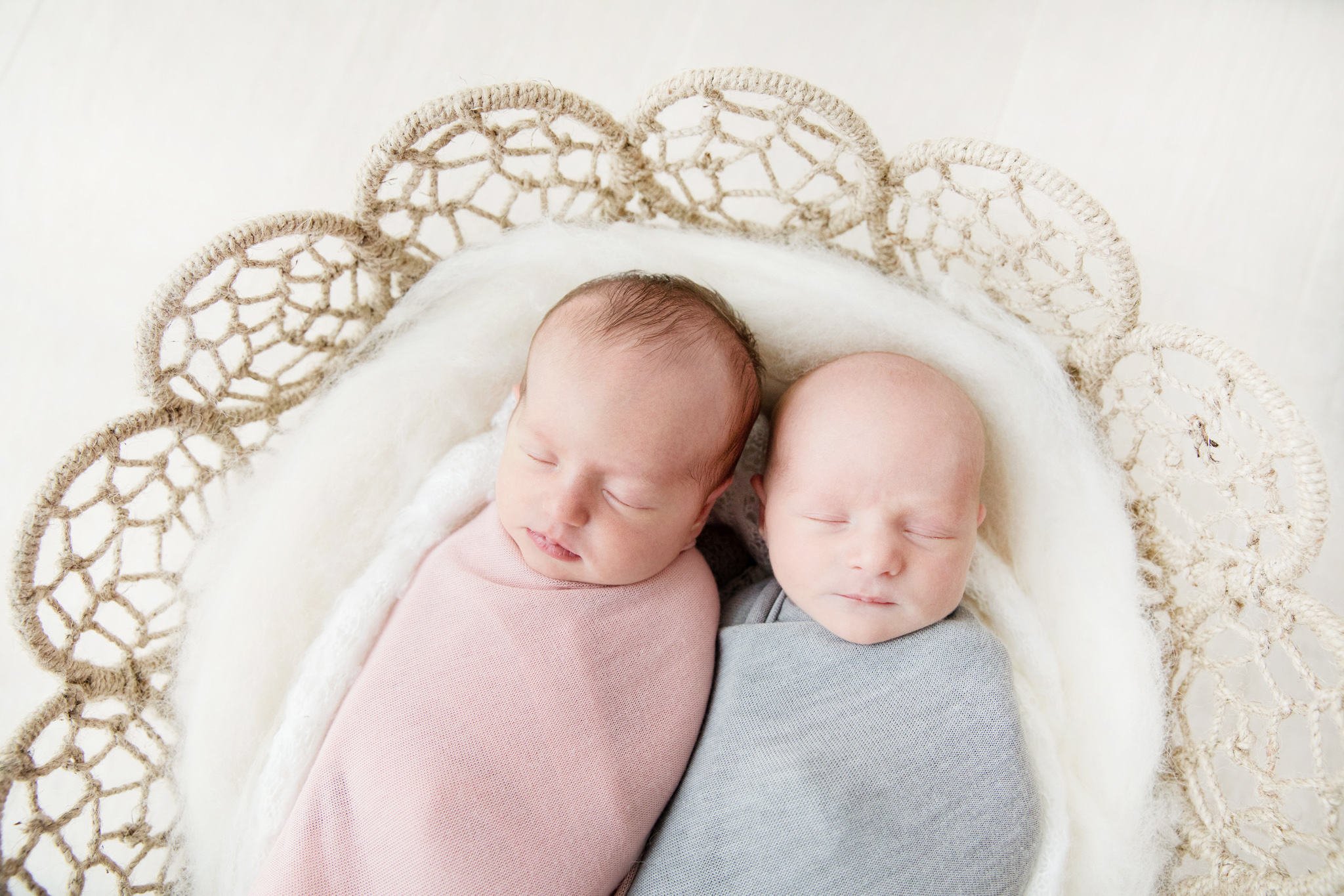 Newborn boy/girl twins in basket together taken at Mel Hill Photography in Canberra.