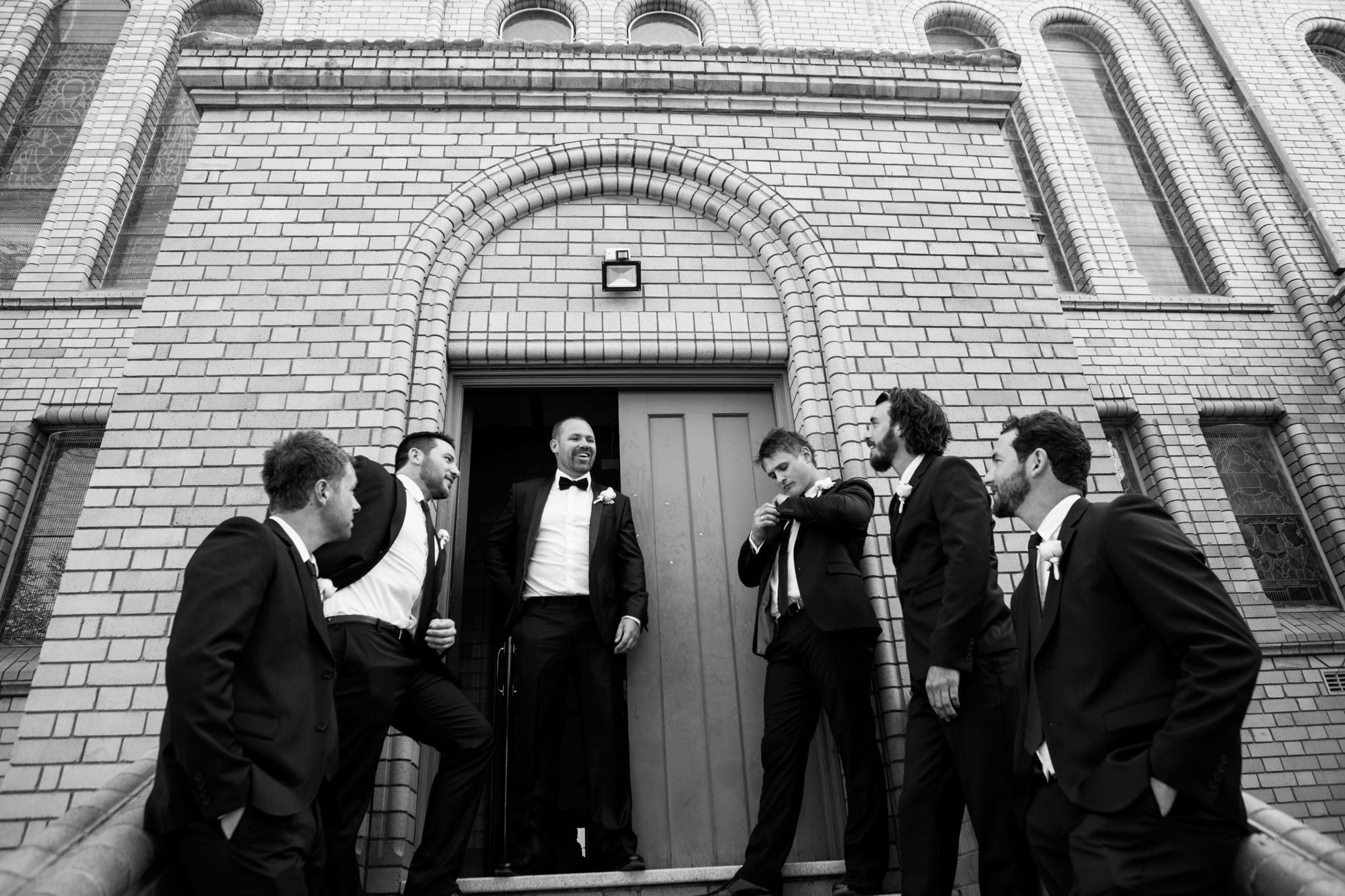 Groom and his groomsmen outside St Christopher's Cathedral Manuka.