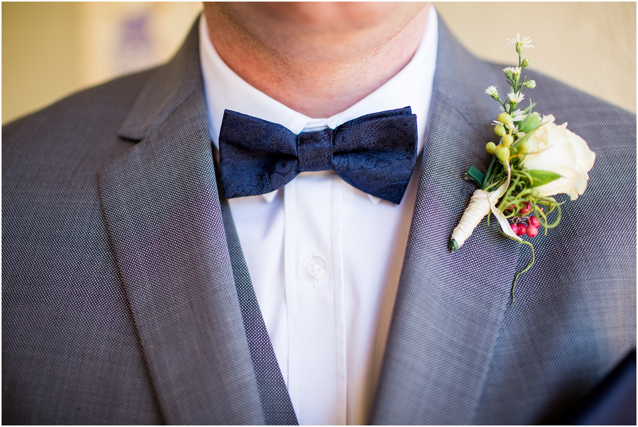 Groom wearing a bow tie at The Chapel at Gold Creek