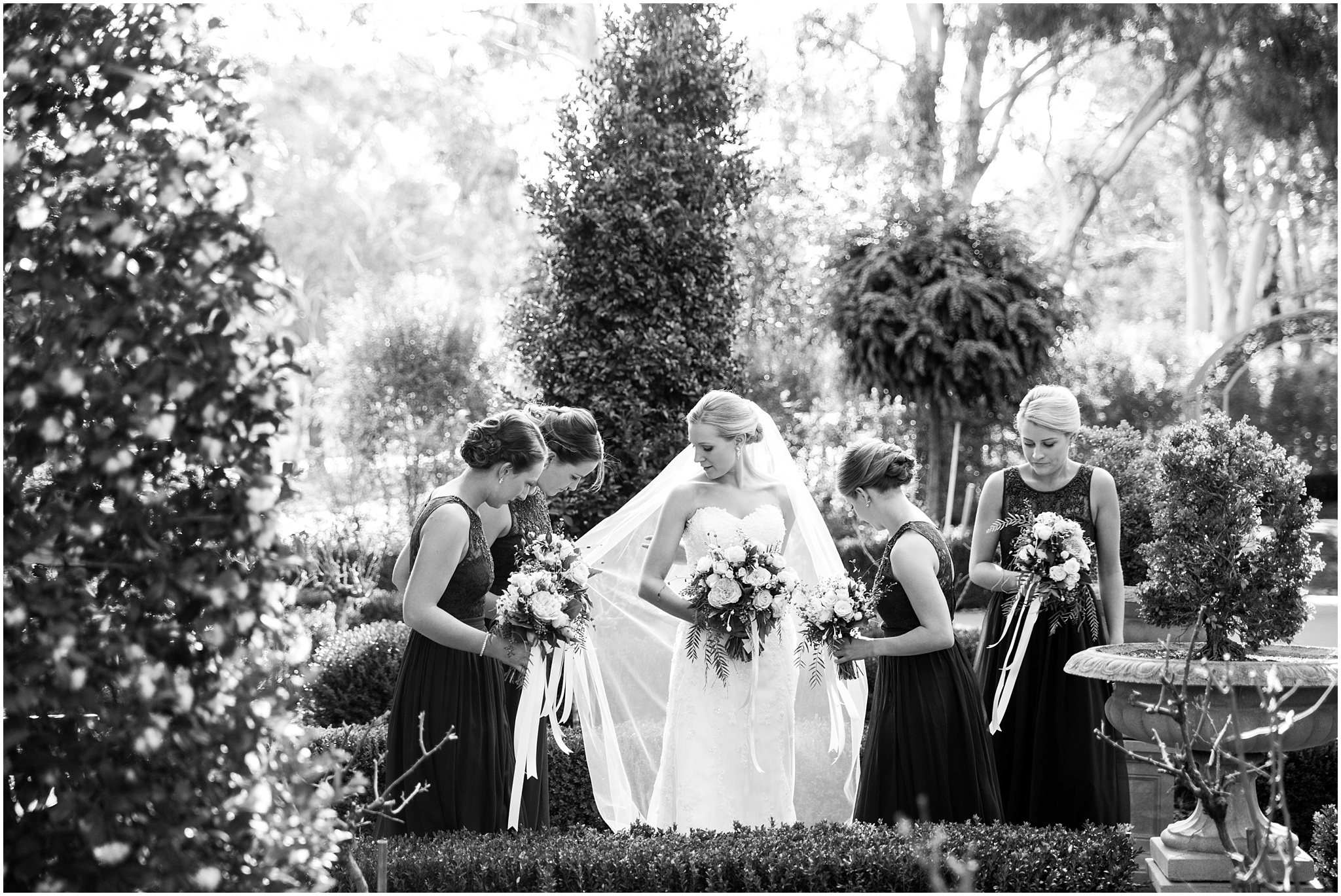 Bride with her bridesmaids at the Gold Creek Chapel near Canberra