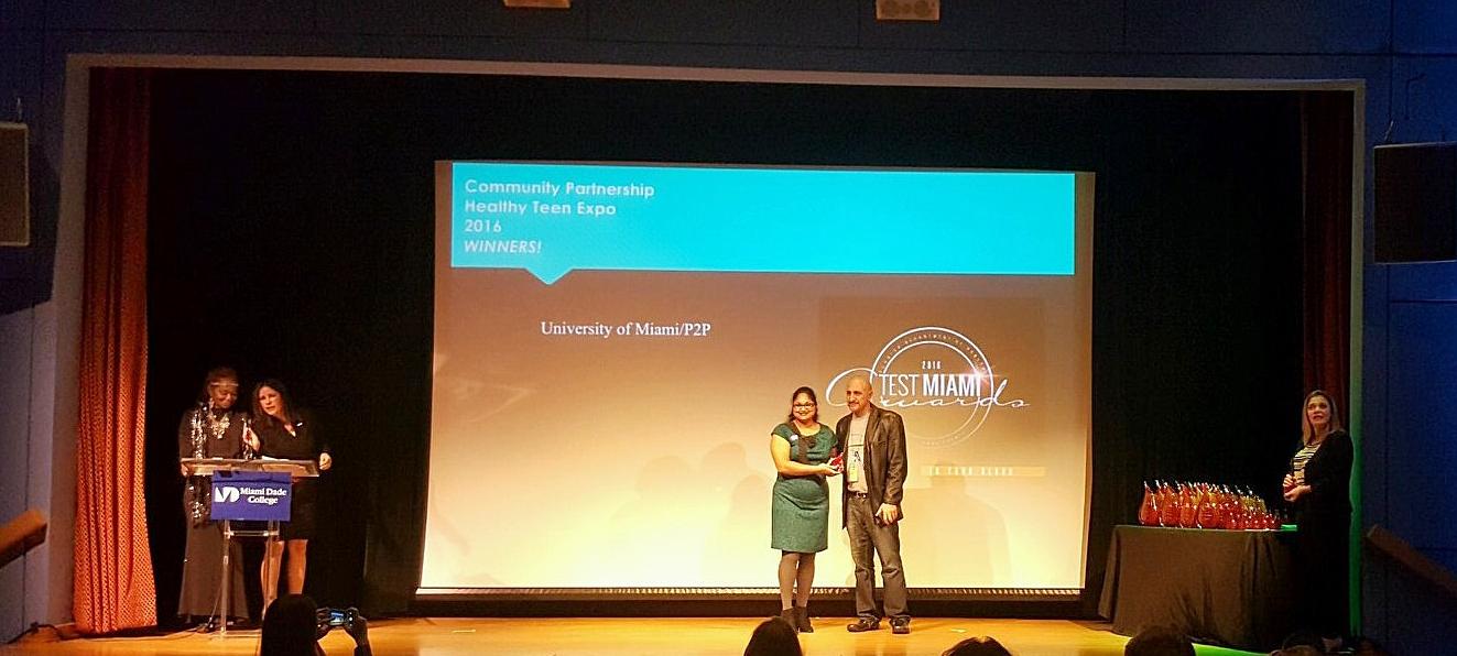 Alex Moreno Accepting P2P Award