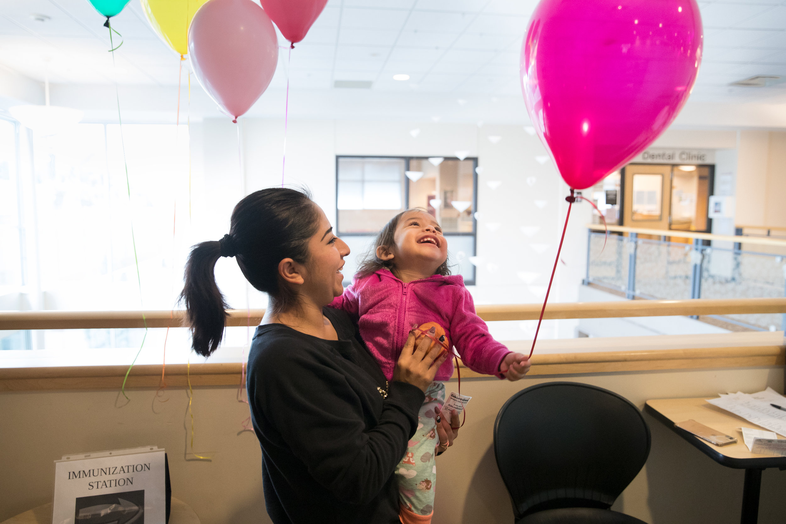 A balloon helps cheer up a child who just received a vaccine at the East County Health Center in Gresham, Ore.
