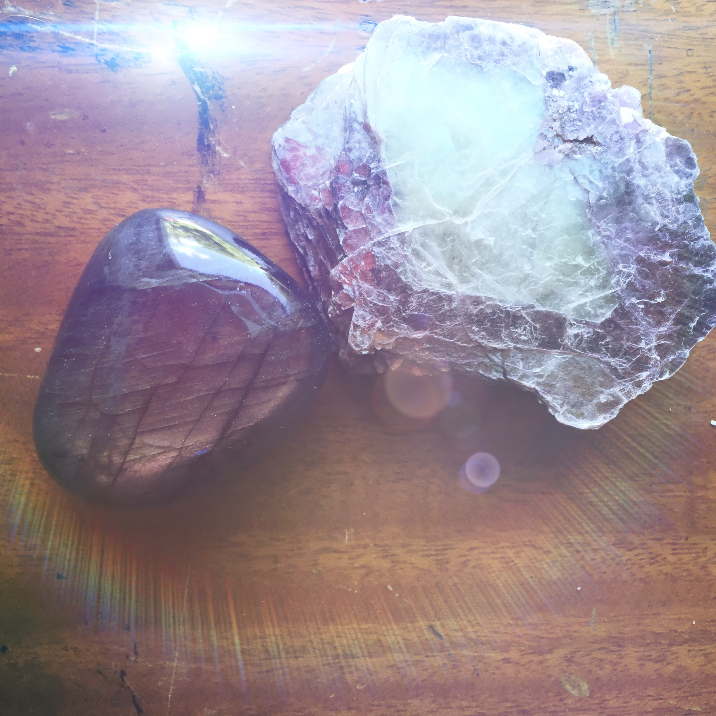 Labradorite (left) and Lepidolite (right) are great crystals for restoring inner peace. The colorful sheen Labradorite offers is enough to distract your mind from all frustration.