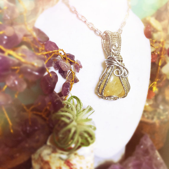 Available on And Zen Some's etsy shop. Wear the bright yellow crystal and notice your inner strength improve greatly.