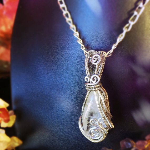 Click the photo above to read more about this Quartz (& Moldavite) wrap.