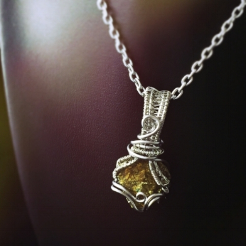 This wire wrapped Chalcopyrite  complements Capricorn's Saturn energy.