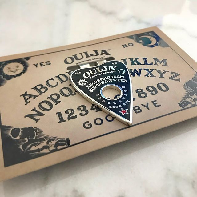 An oldie but a goodie!  Custom Ouija planchette money clip with Ouija board packaging.  Officially licensed and made exclusively for Horror Block in 2016. Did you have one?  #oldiebutgoodie #moneyclip #custommerchandise #ouija #ouijaboard #horror #hardenamel #hasbro @hasbro #waxoffdesign