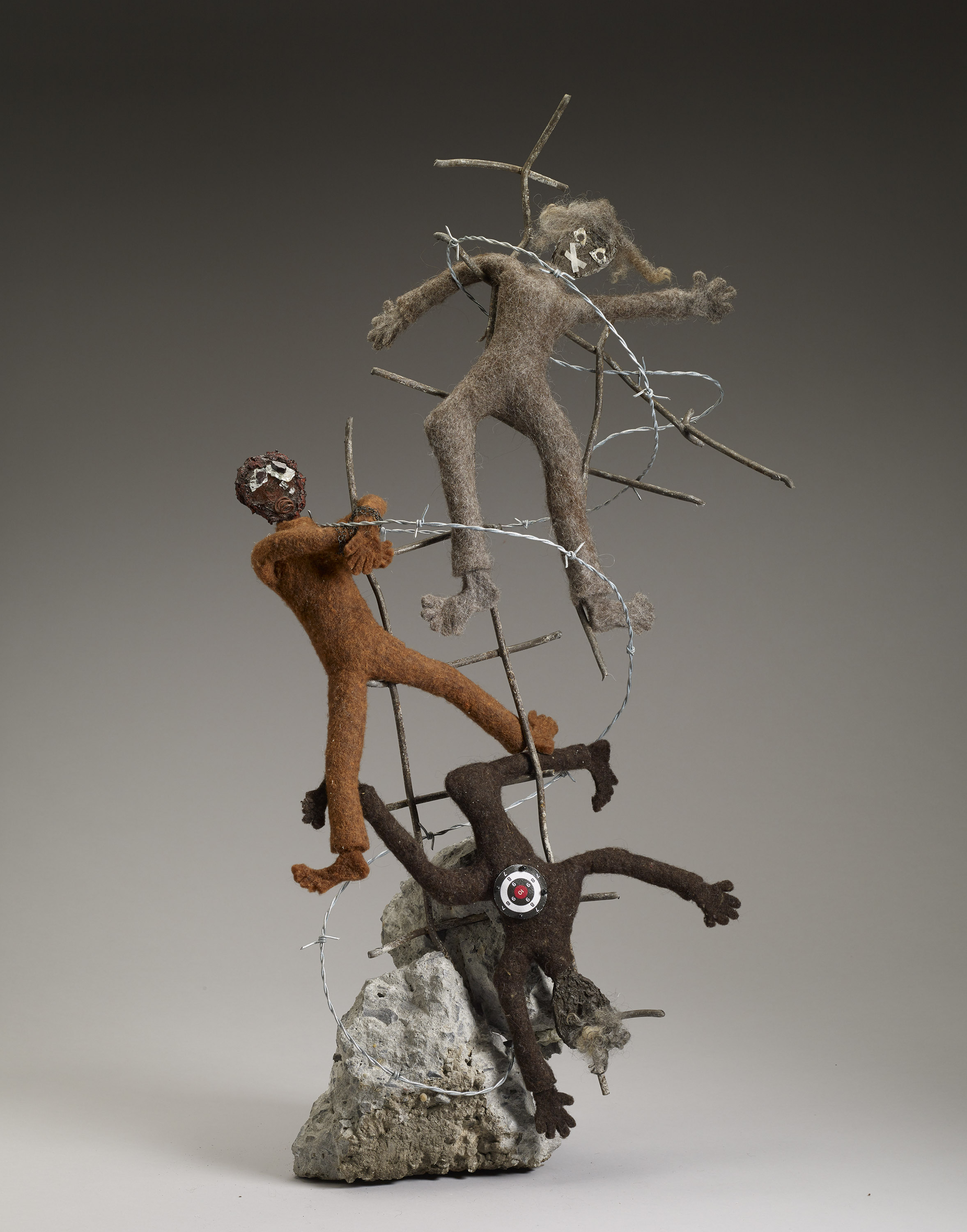 """""""Banned Bodies,"""" hand-felted fiber and mixed media, 33"""" x 15"""" x 7"""""""