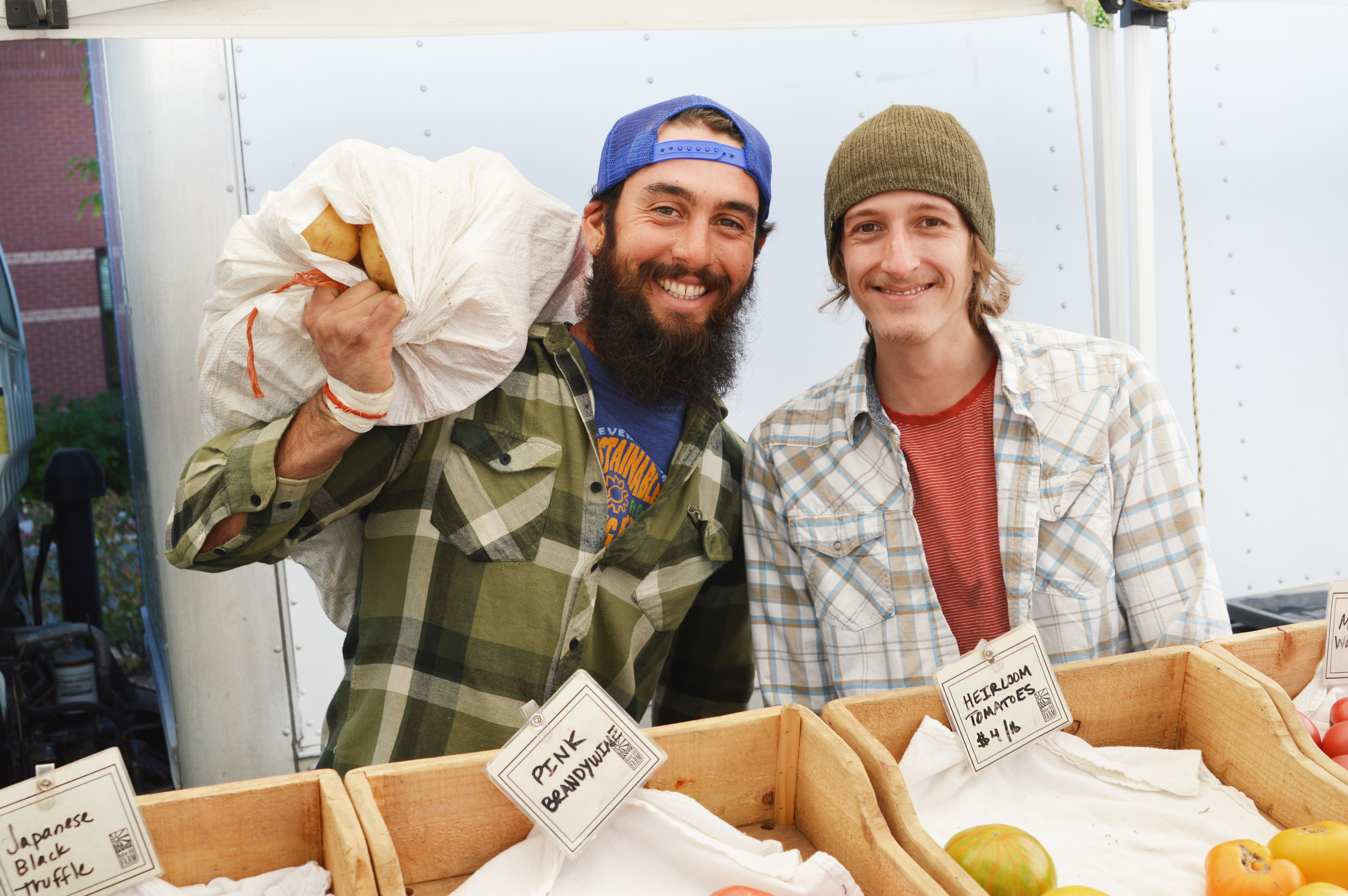 Happy farmers, healthy food! (Photo by Claire Burnett)