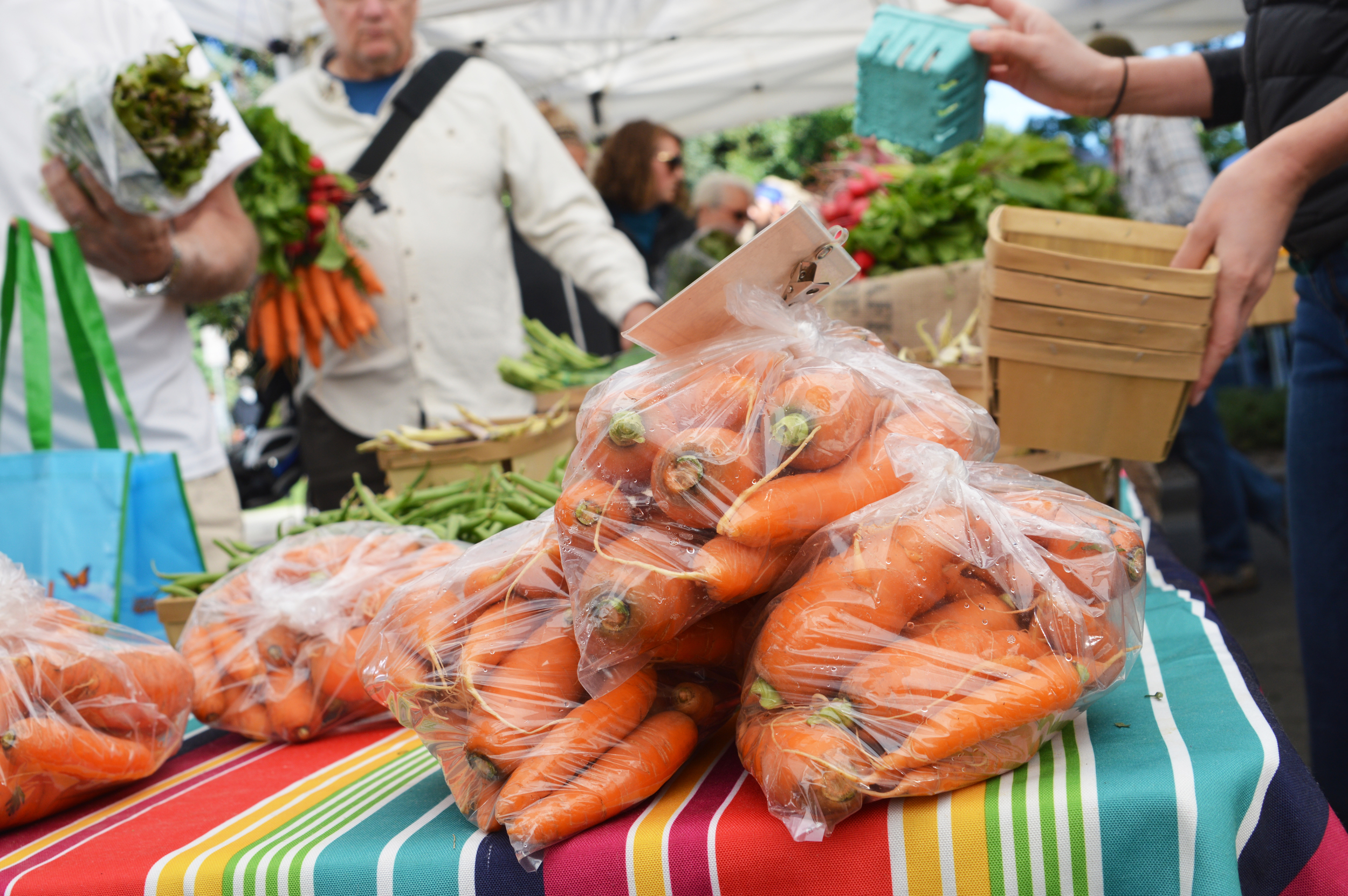 A full Saturday Market stand makes everyone happy! (Photo by Claire Burnett)